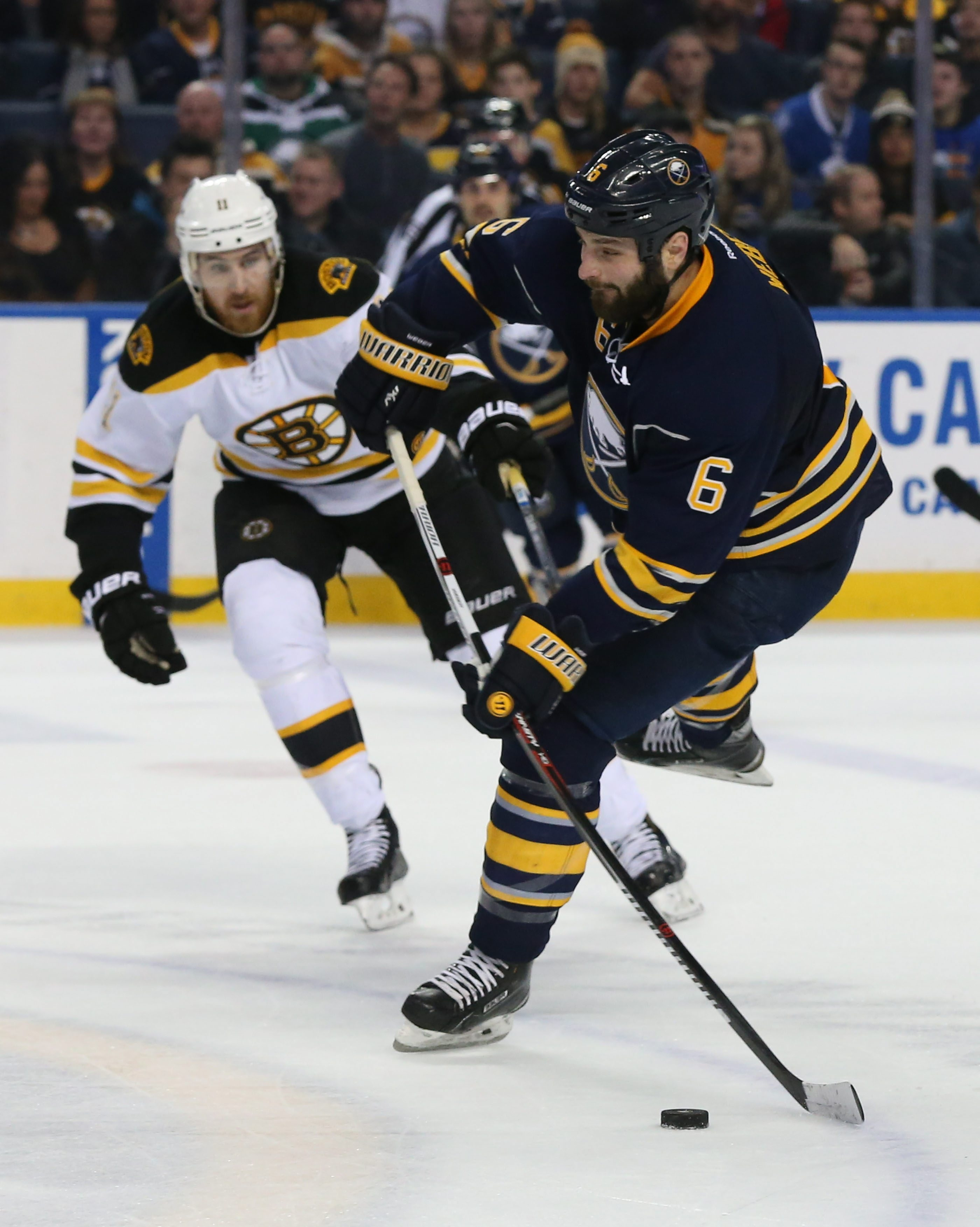 Mike Weber shoots the puck in the first period against the Boston Bruins Friday at First Niagara Center.