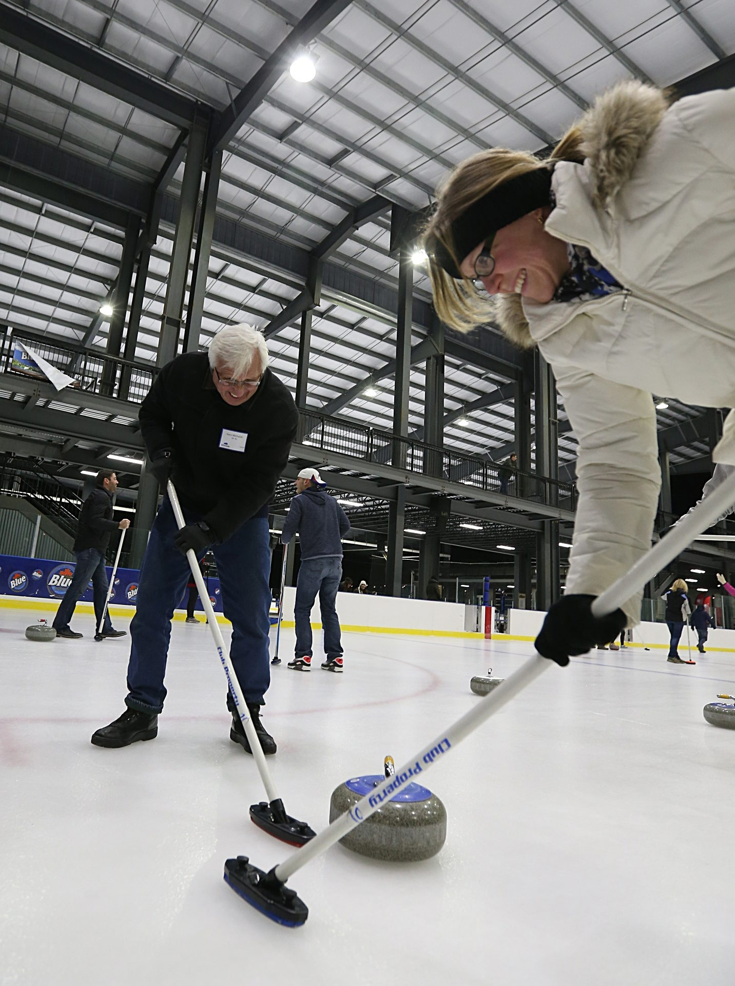 Gary Michalski and his daughter-in-law Amy Michalski participate in a learn-to-curl event offered by the Buffalo Curling Club earlier this month at RiverWorks.