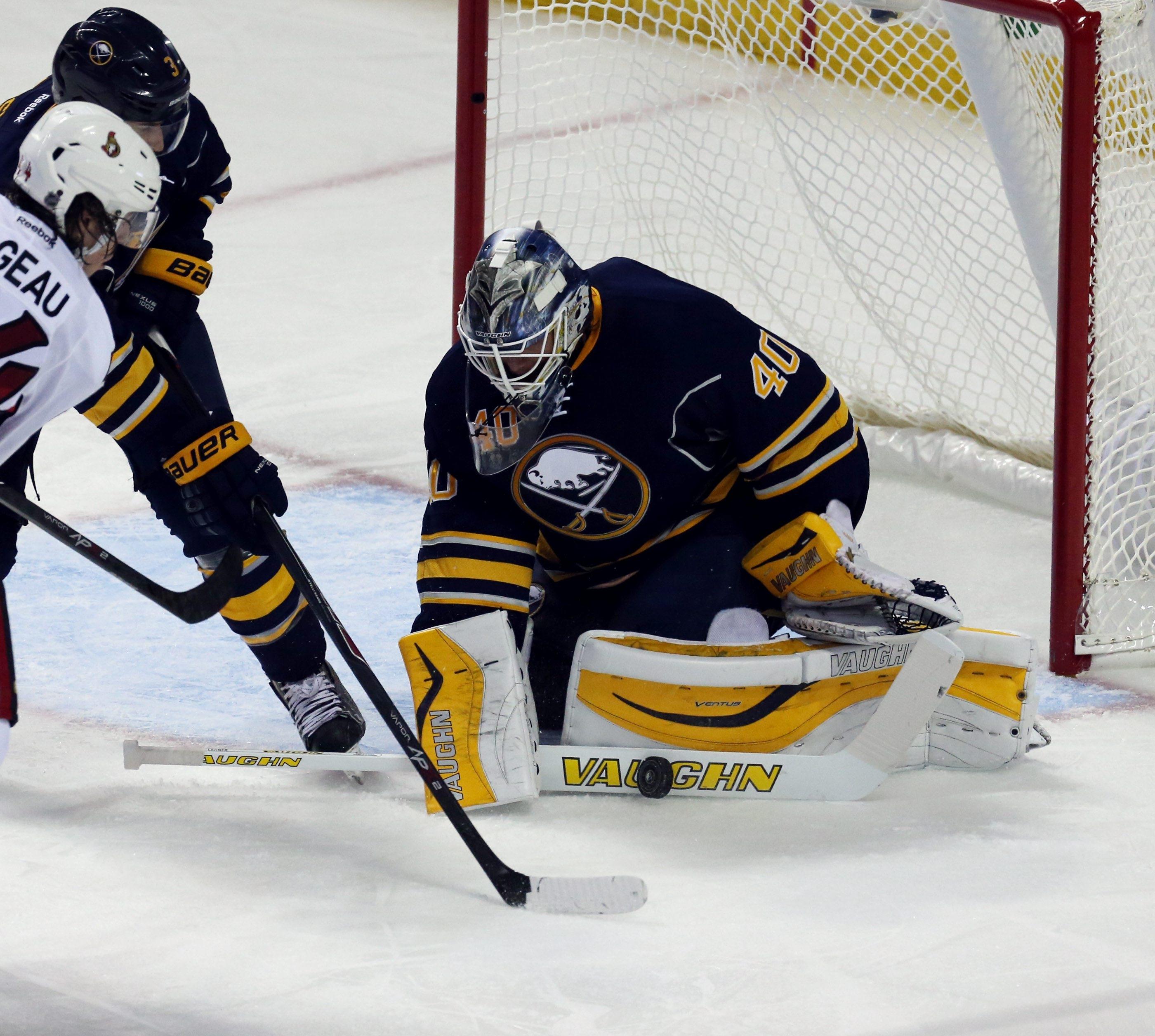Buffalo Sabres goalie Robin Lehner (40) makes a save in the second period at First Niagara Center in Buffalo,NY on Thursday, Oct. 8, 2015.  (James P. McCoy/ Buffalo News)