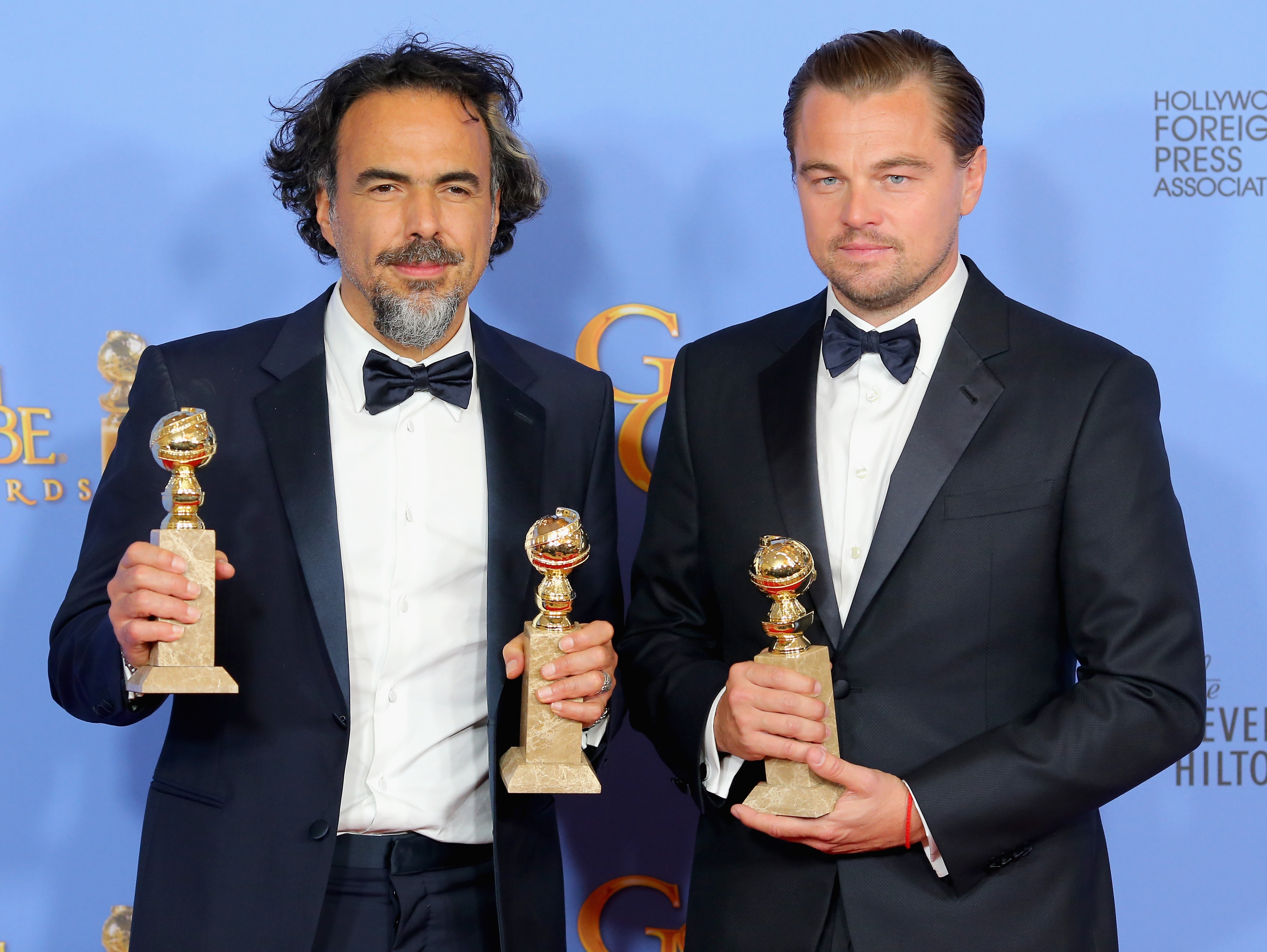 BEVERLY HILLS, CA - JANUARY 10:  Director Alejandro Gonzalez Inarritu (L), winner of Best Motion Picture - Drama and Best Director - Motion Picture for 'The Revenant,' and actor Leonardo DiCaprio, winner of Best Performance by an Actor in a Motion Picture - Drama for 'The Revenant,' poses in the press room during the 73rd Annual Golden Globe Awards held at the Beverly Hilton Hotel on January 10, 2016 in Beverly Hills, California.  (Photo by Mark Davis/Getty Images)