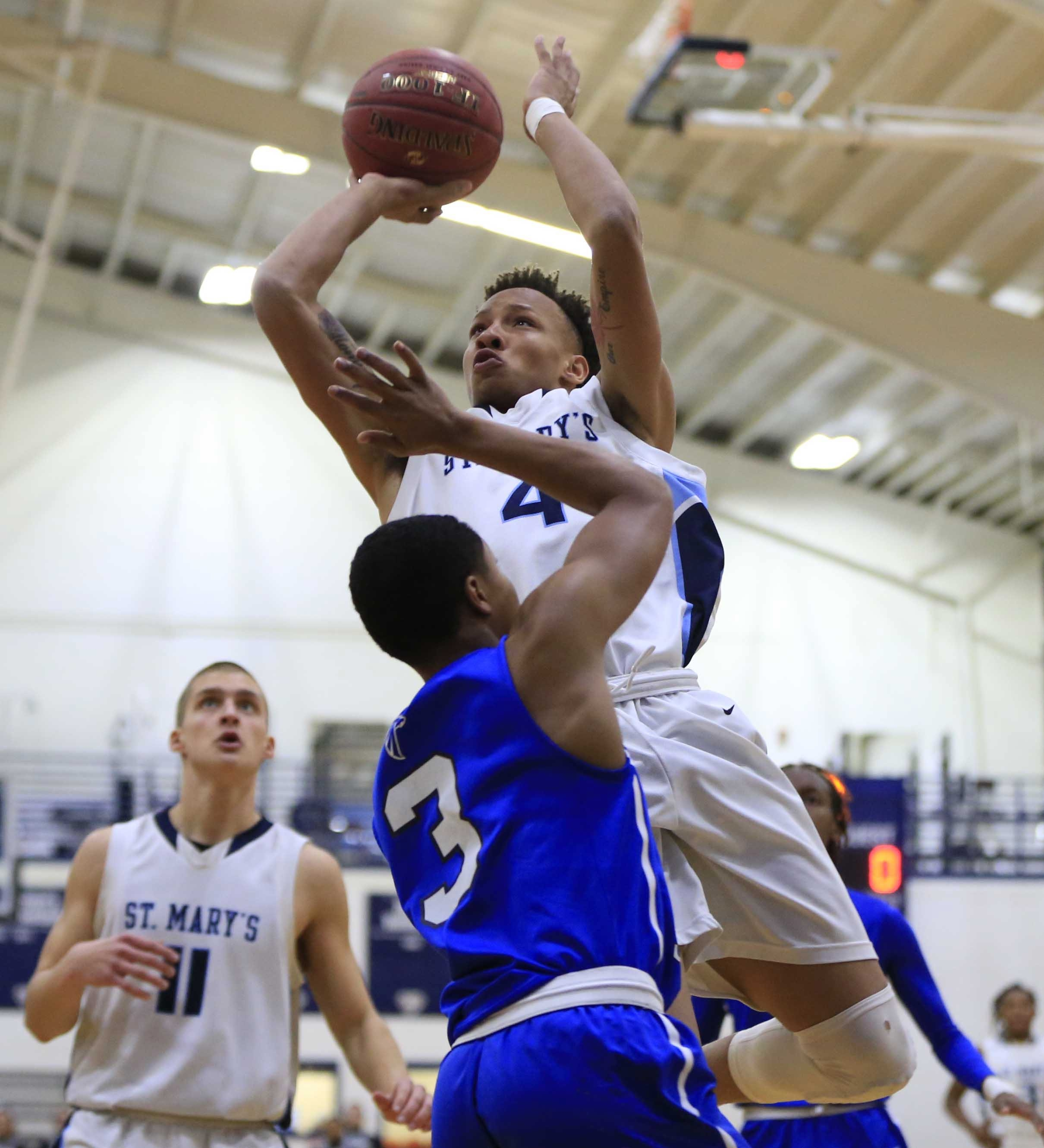Takal Molson drives to the basket on Health Sciences' Kameron Briggs during the Lancers' 68-37 rout in Lancaster Wednesday.