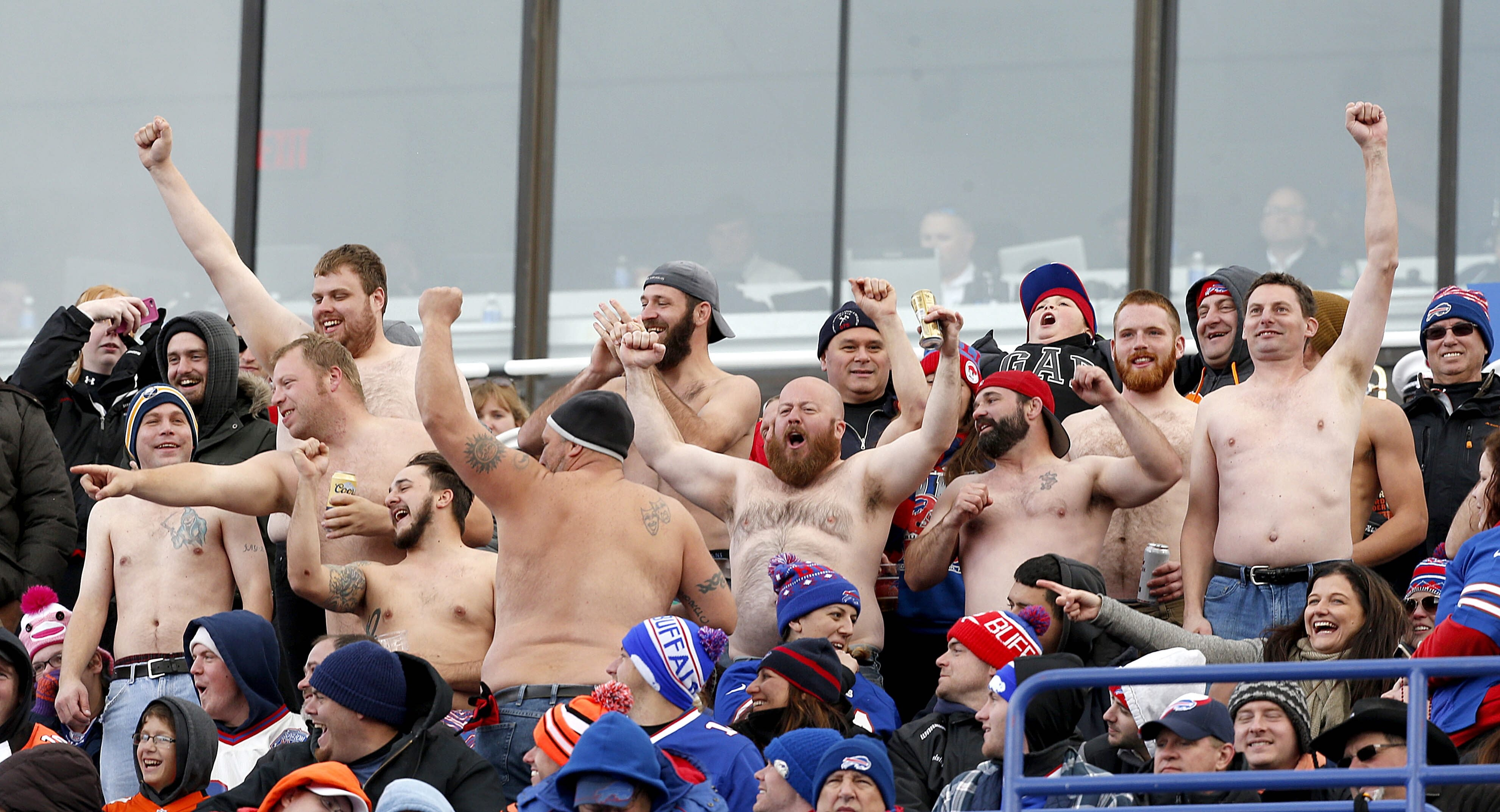 The sight of Bills fans going shirtless while the snow flies, in this October photo of Bills vs. Bengals game at Ralph Wilson Stadium, pales in comparison to the tailgating antics of a few fans captured on cellphone videos.  (Robert Kirkham/Buffalo News)