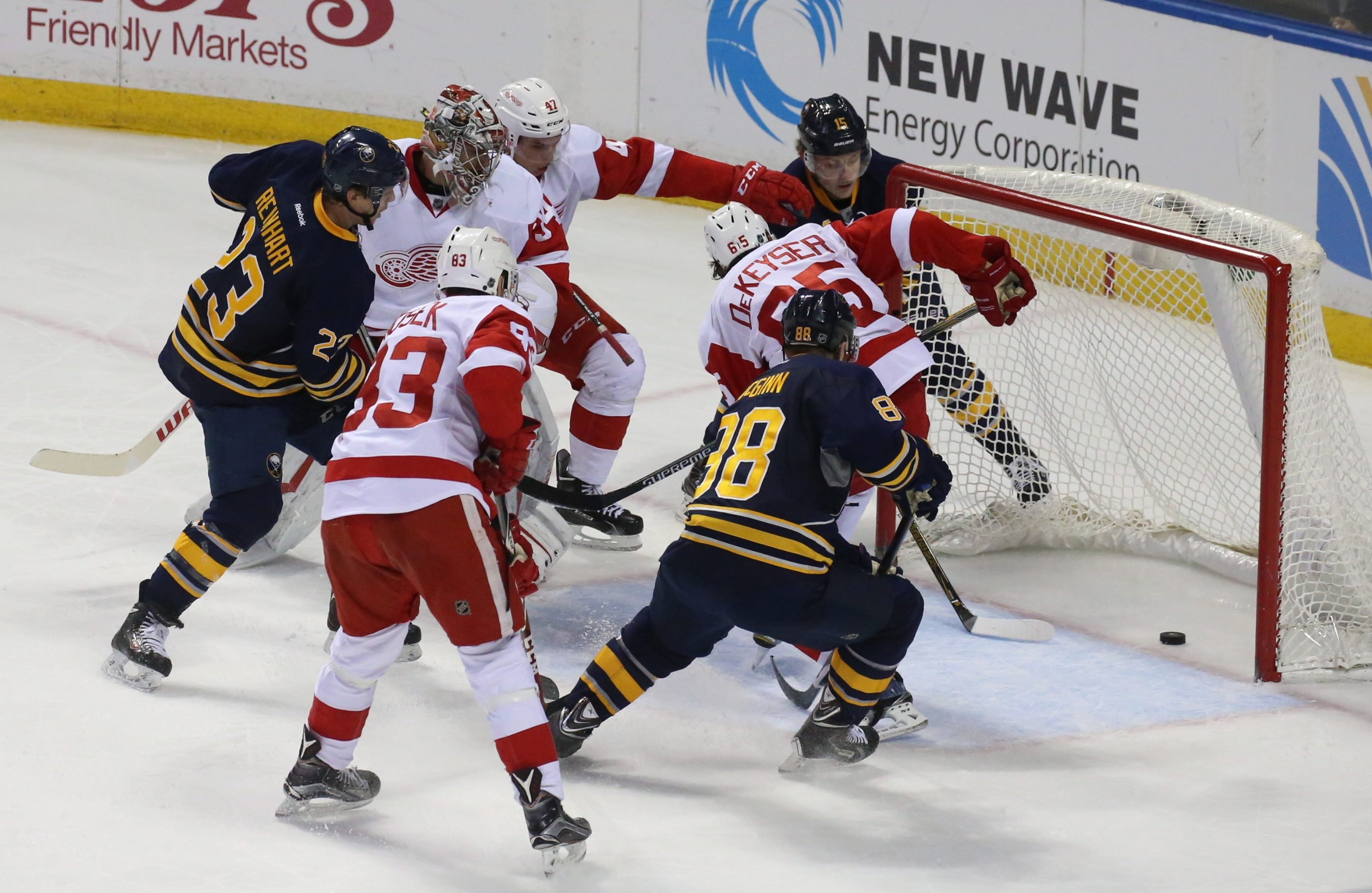 Buffalo's Sam Reinhart scores in a scrum Saturday in front of the Detroit net at First Niagara Center. The Sabres lost to the Red Wings, 4-3.