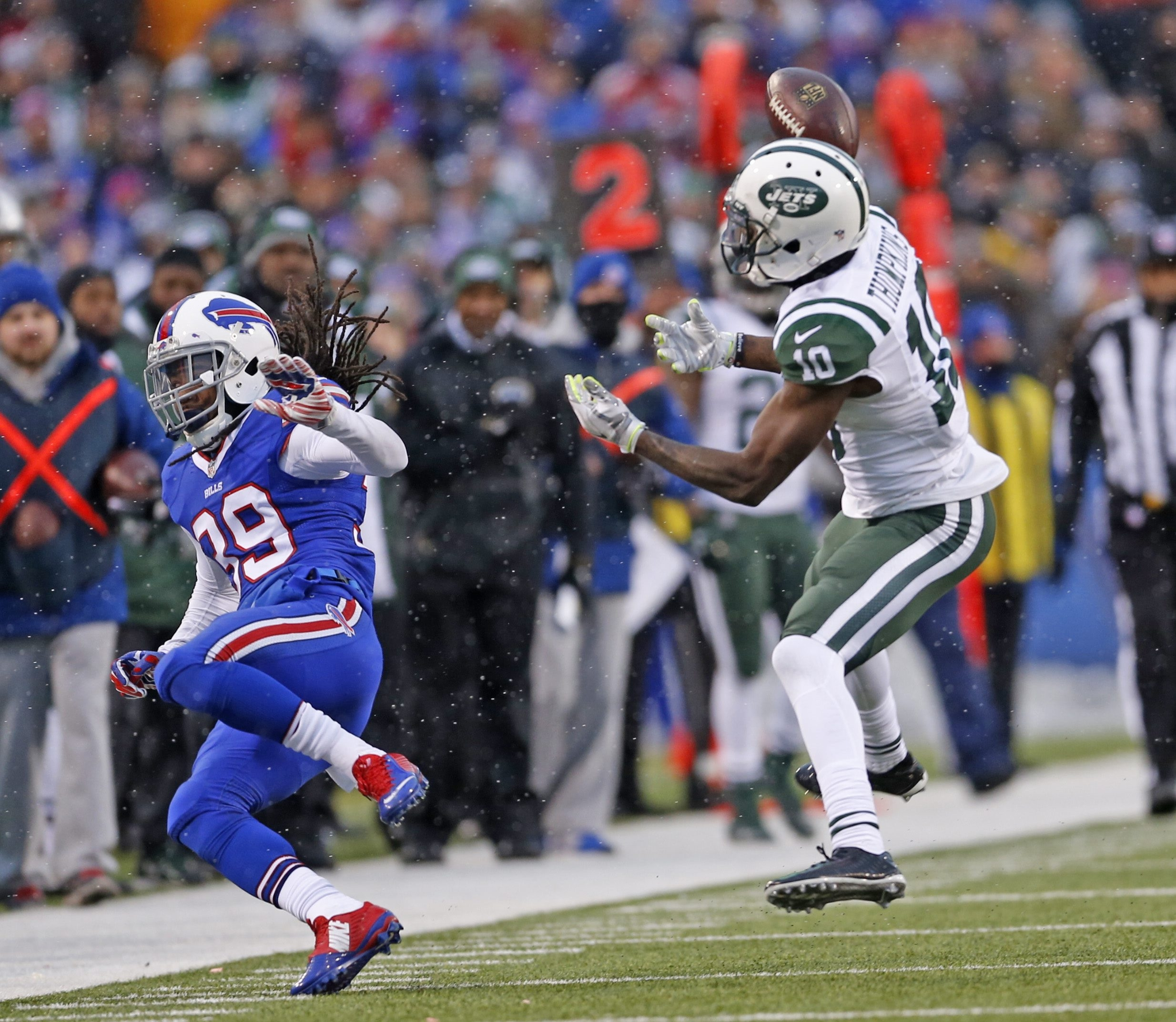 Jets receiver Kenbrell Thomkpkins gets the ball knocked out of his hands by Bills defensive back Mario Butler in a game-saving play with 17 seconds left to go.