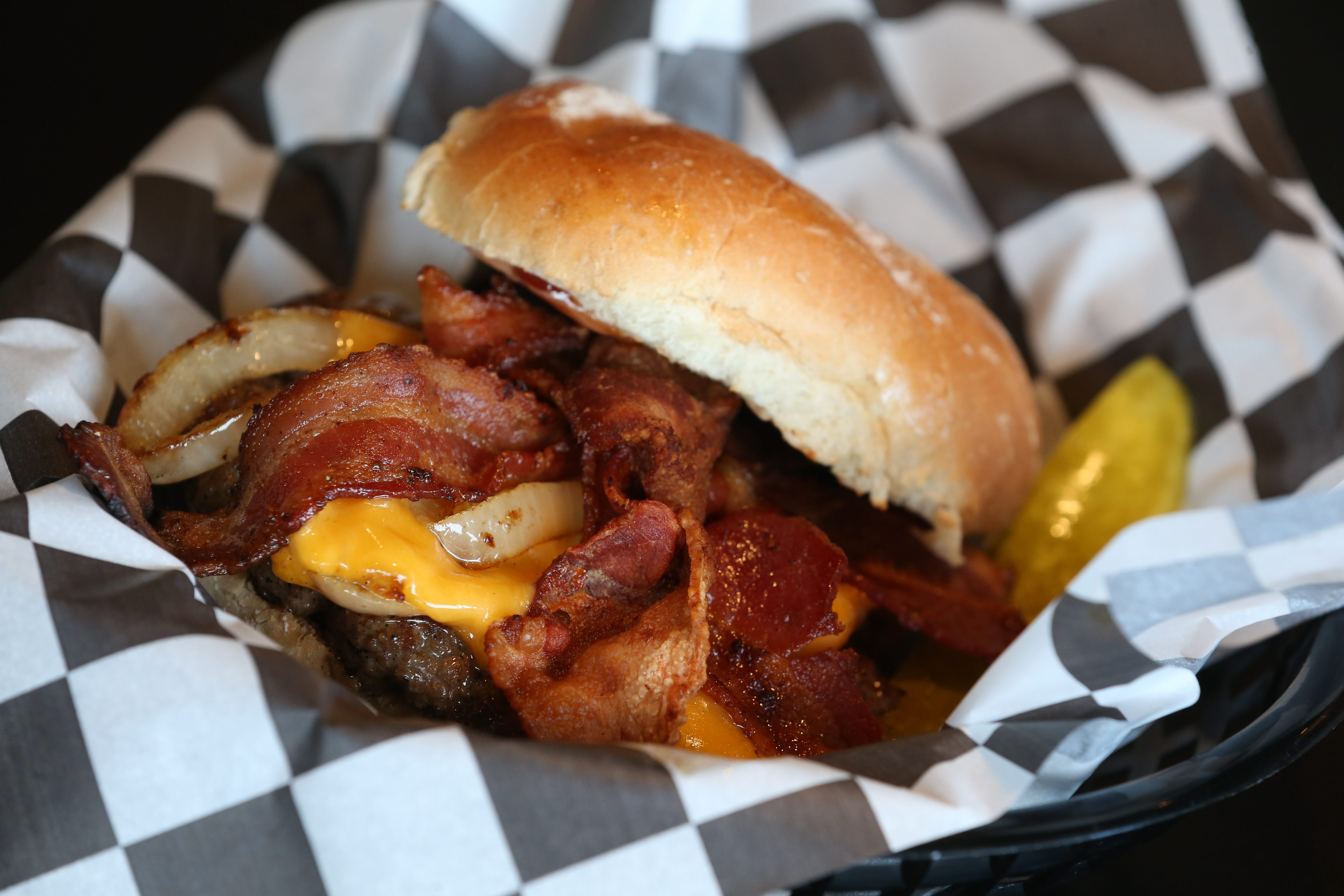 The Carmine burger at Bugsy's Burger Bar comes with applewood smoke bacon, caramelized onions, cheddar and barbecue mayo. (Sharon Cantillon/Buffalo News)