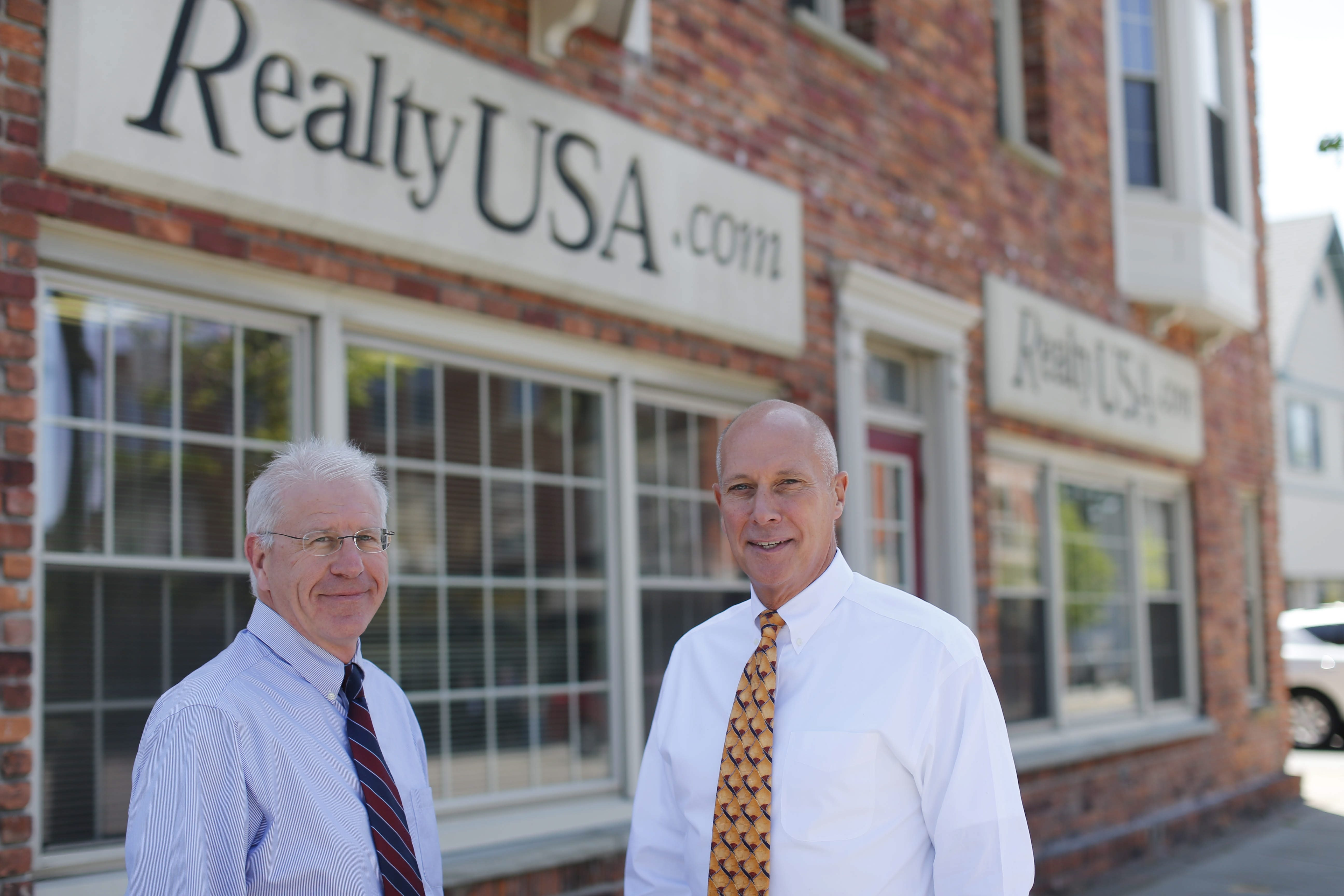 Curtis Neureuter, left, manager of the Orchard Park office of Realty USA, and President and CEO Merle L. Whitehead, seen at their Orchard Park office, lead the largest independent real estate brokerage firm in the state.