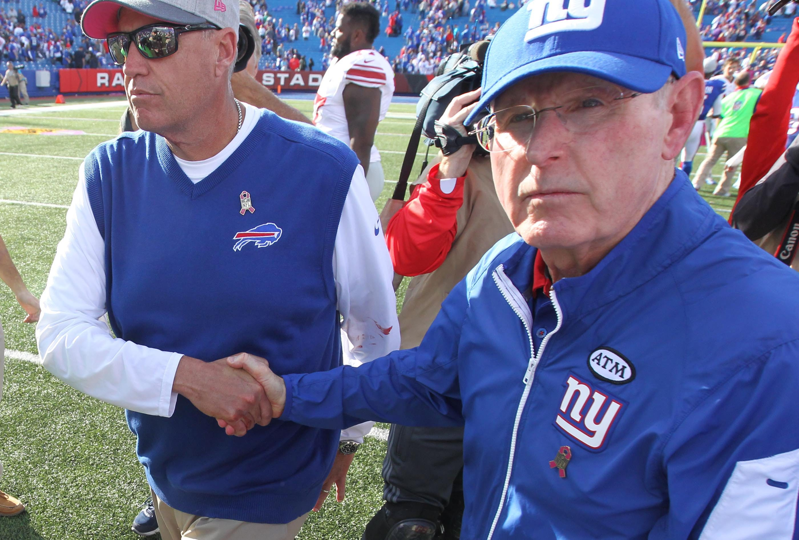 Tom Coughlin shakes hands with Bills coach Rex Ryan after the Giants won in Buffalo in Week Four of this past season.