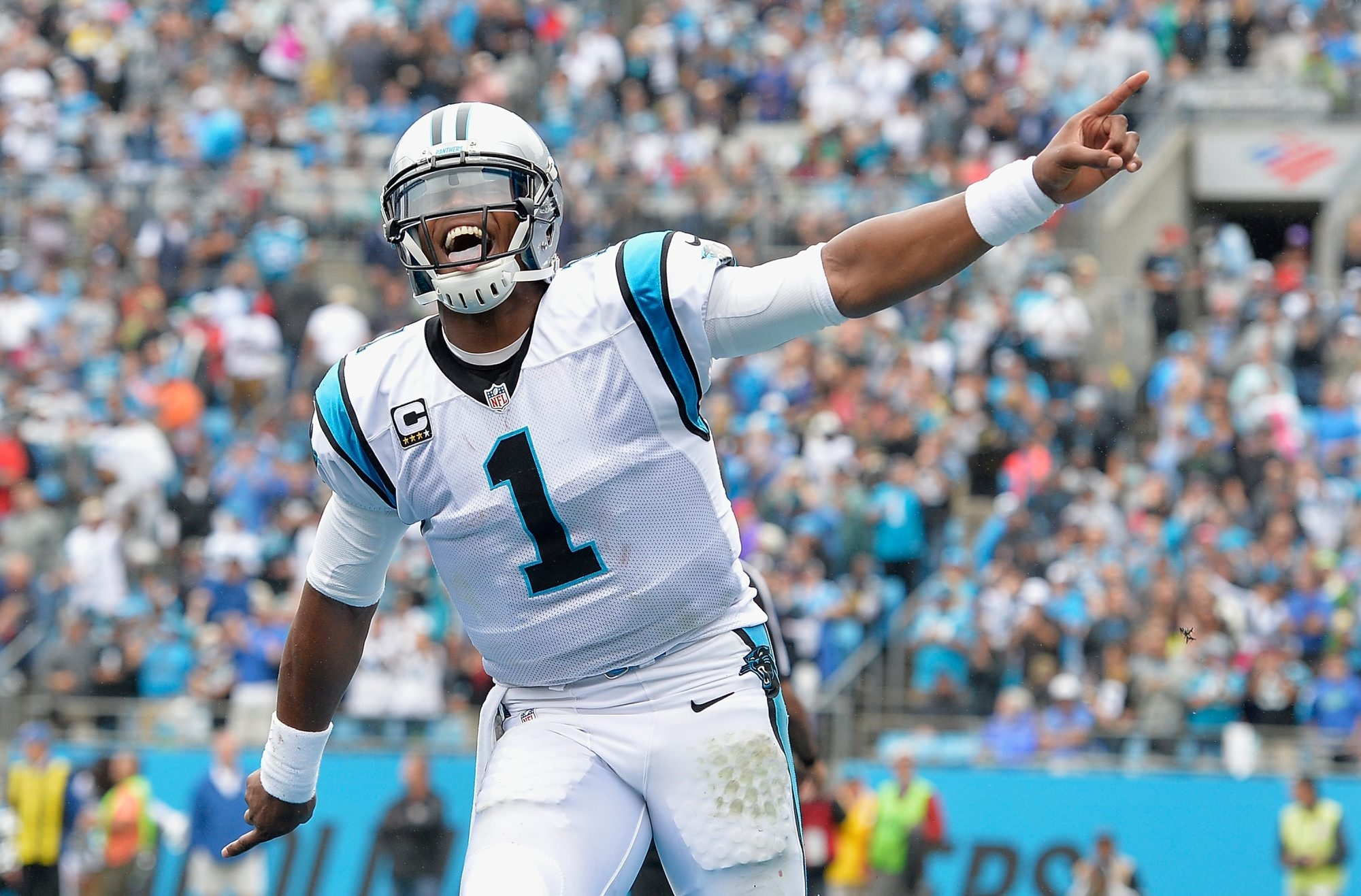 2LINE CUTLINE Cam Newton of the Carolina Panthers reacts after throwing for a touchdown against the New Orleans Saints during their game at Bank of America Stadium on September 27, 2015 in Charlotte, North Carolina.  (Photo by Grant Halverson/Getty Images)