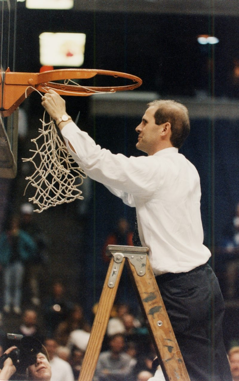 Canisius basketball coach John Beilein cuts down the net after winning the 1996 MAAC title in Albany.