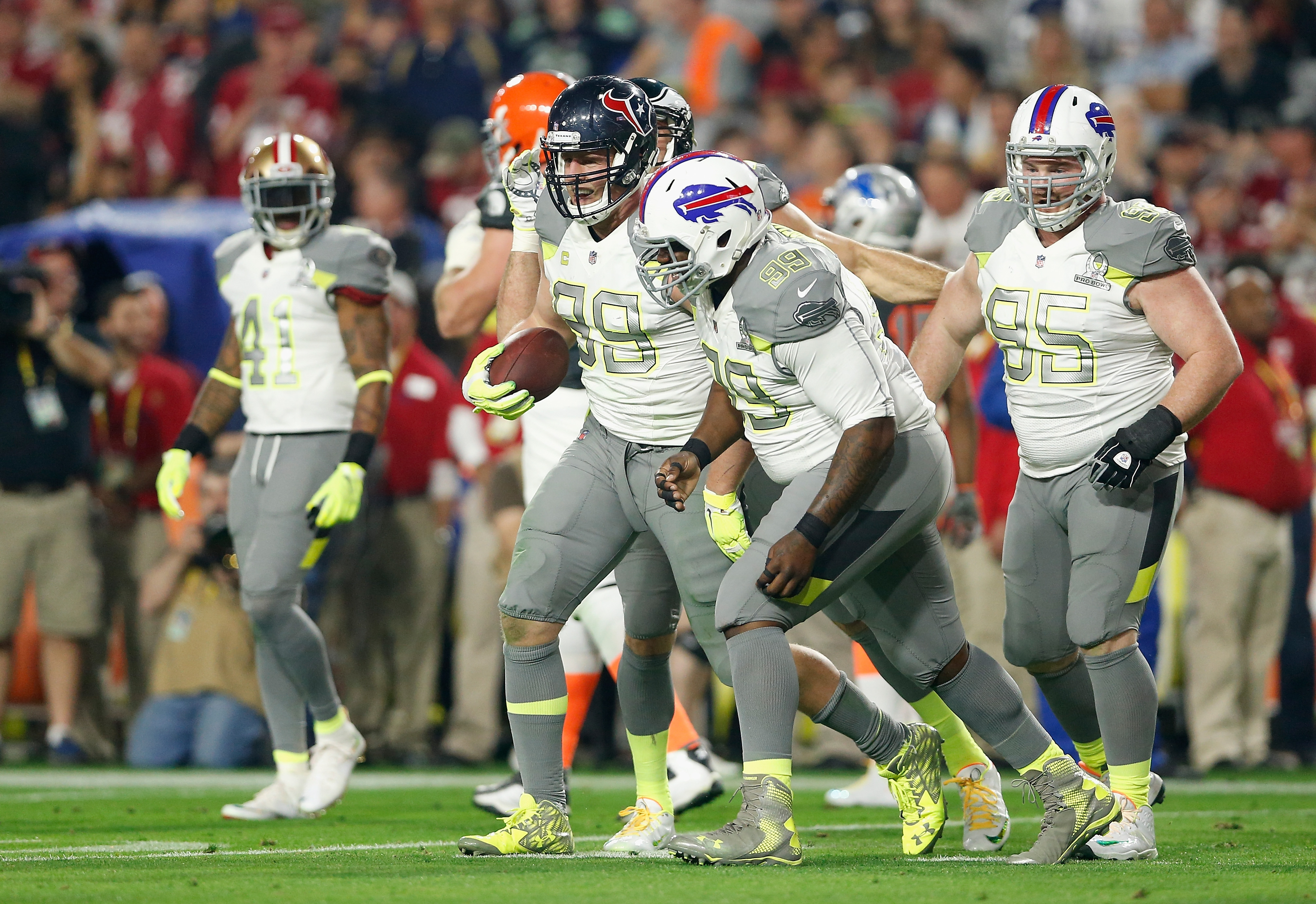 Team Carter defensive end J.J. Watt #99 of the Houston Texans (left), defensive tackle Marcell Dareus (99) and Kyle Williams of the Buffalo Bills (right) celebrate during the first half of the 2015 Pro Bowl.