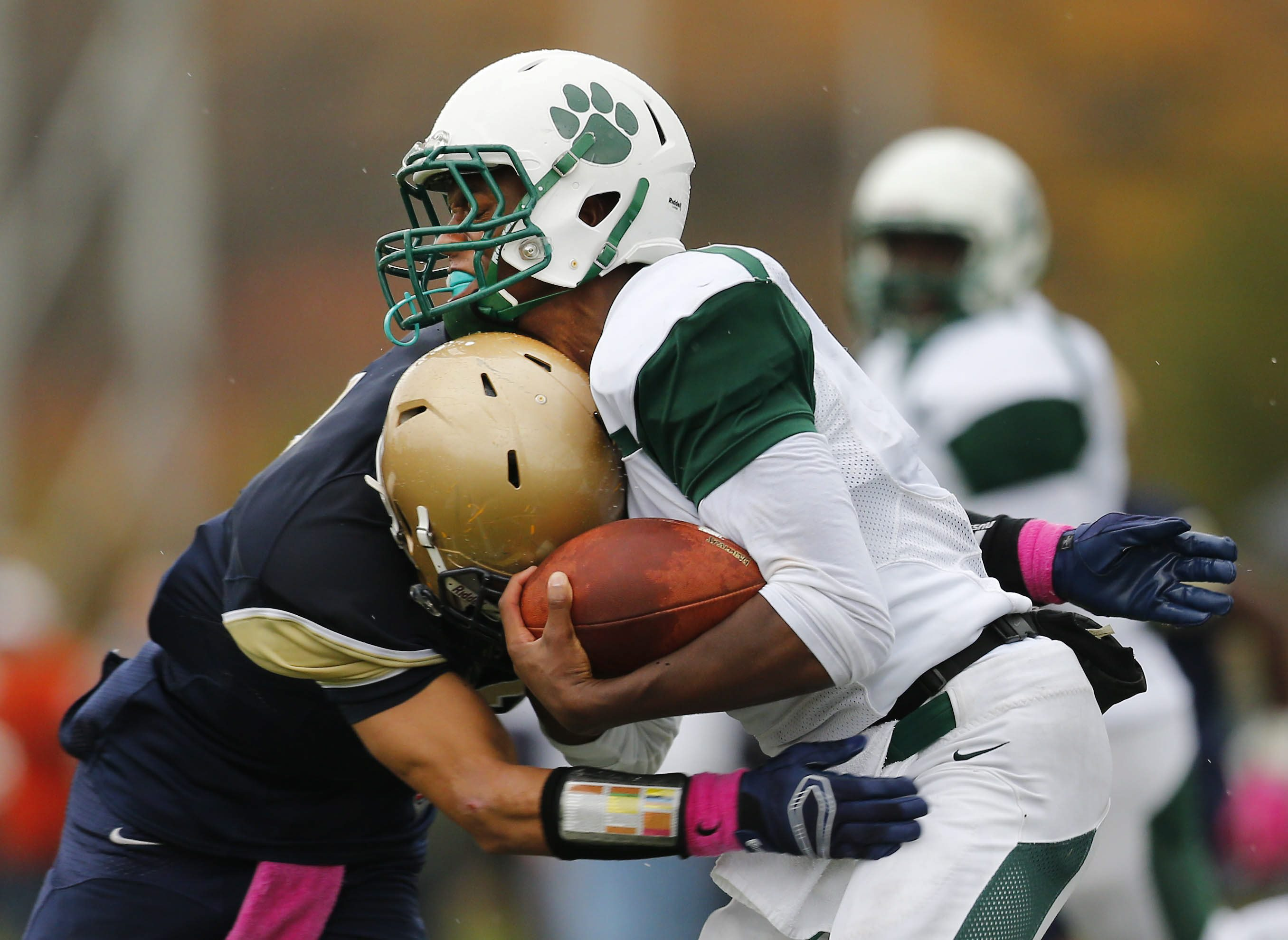 Canisius' Justin Jones drills Timon's Tyler Ringwood during an October clash between the Monsignor Martin Association rivals.  (Mark Mulville/Buffalo News)