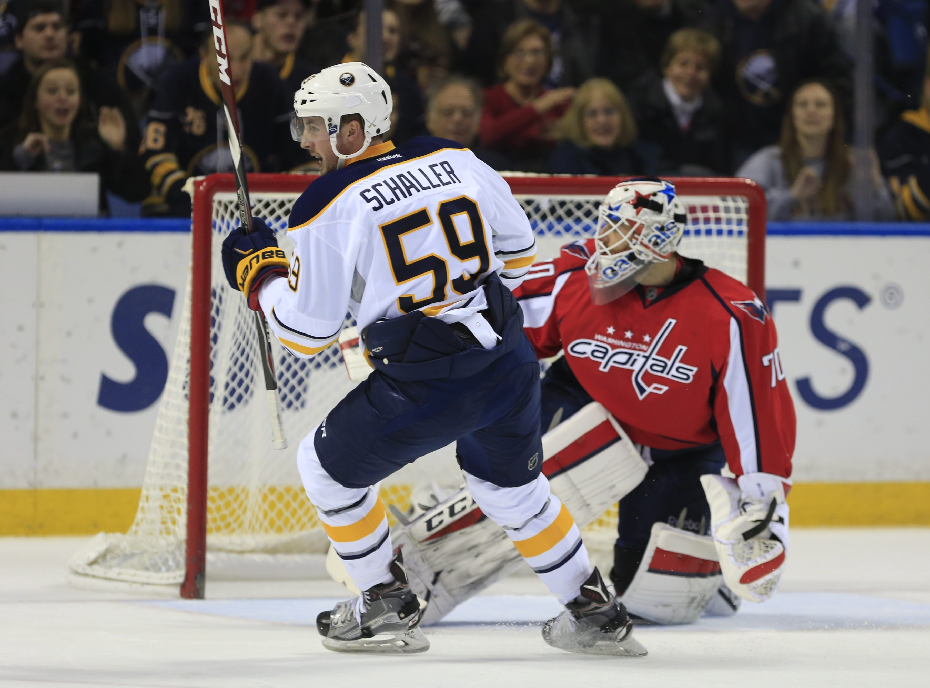 Buffalo's Tim Schaller celebrates the Sabres' second goal of the game against Capitals goaltender Braden Holtby.