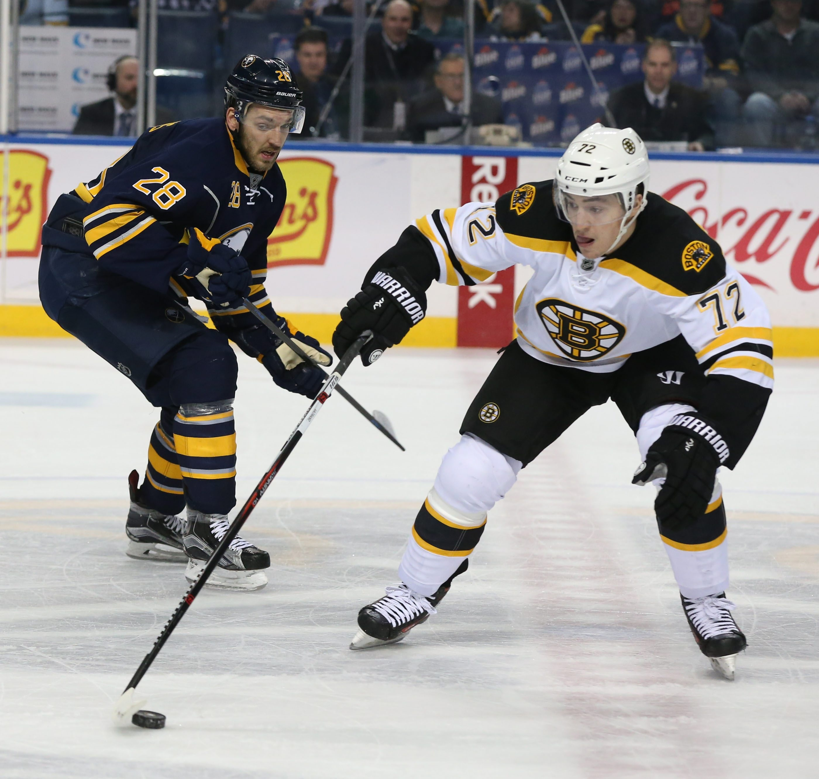 Buffalo Sabres center Zemgus Girgensons (28) battles Boston Bruins center Frank Vatrano (72) for the puck in the first period at First Niagara Center in Buffalo, NY on Friday, Jan. 15, 2016.  (James P. McCoy/ Buffalo News)
