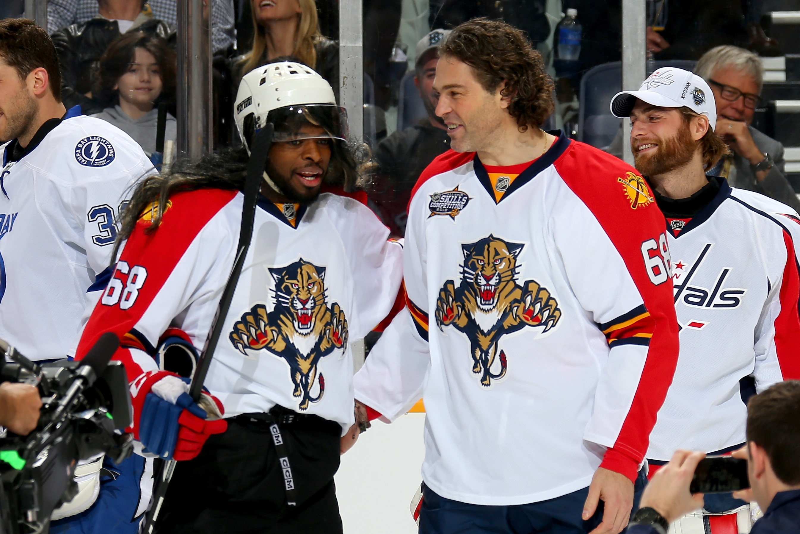 P.K. Subban of the Montreal Canadiens, left, donned a mullet wig and Jaromir Jagr jersey to pay tribute to the real Jagr, right, at the All-Star Skills Competition in Nashville Saturday.