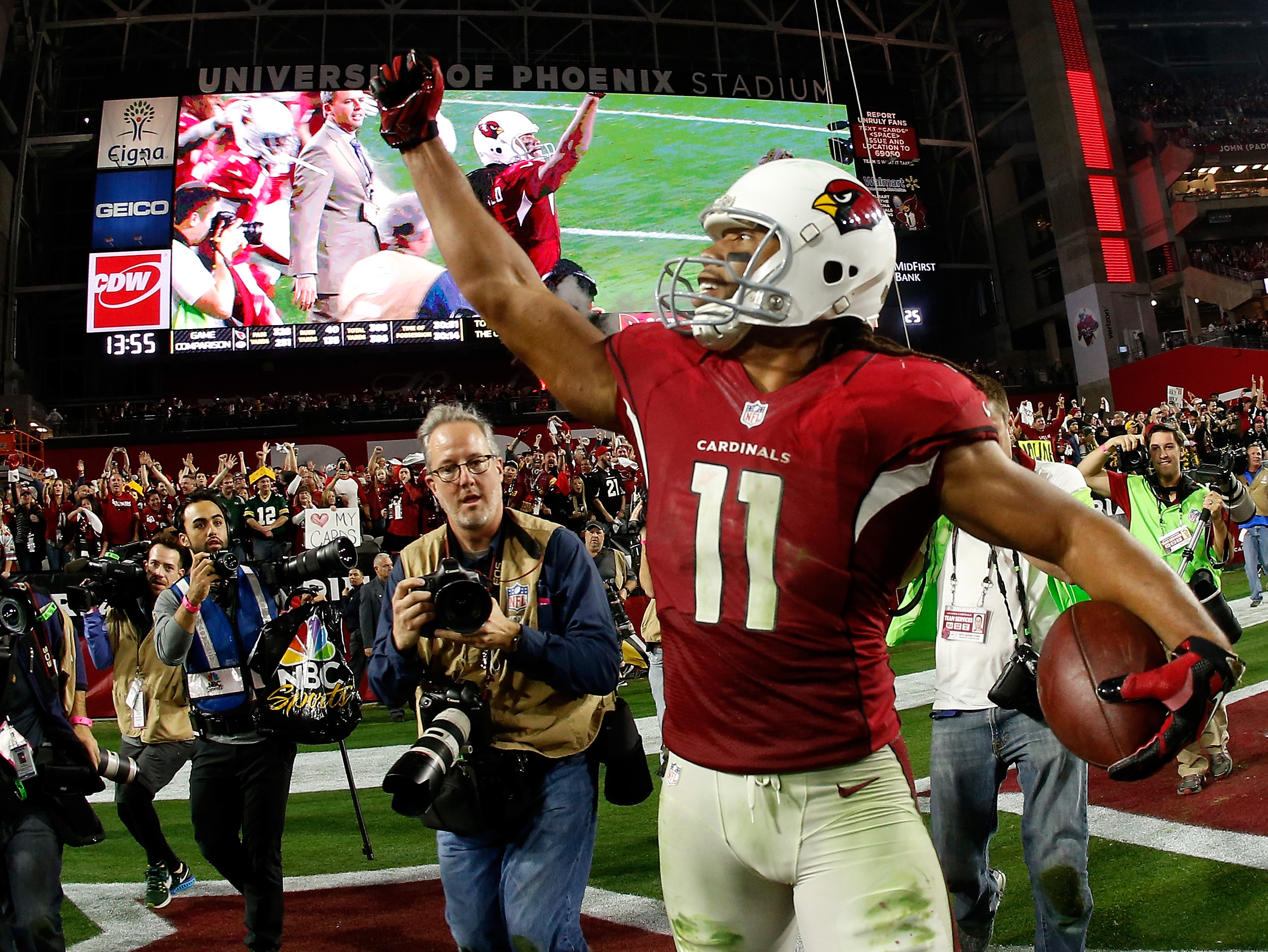 Wide receiver Larry Fitzgerald of the Arizona Cardinals celebrates his game-winning touchdown in overtime of the NFC Divisional Playoff Game. (Getty Images)
