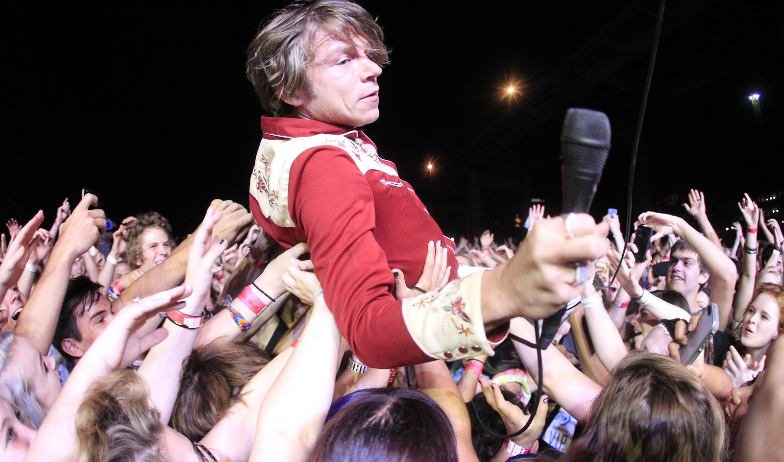Cage the Elephant lead singer Matt Schultz entertains the crowd at Kerfuffle at Canalside on July 26, 2014. His band stole the show at Alternative Buffalo's Spring Fling, Jeff Miers wrote. (Harry Scull Jr. /Buffalo News file photo)