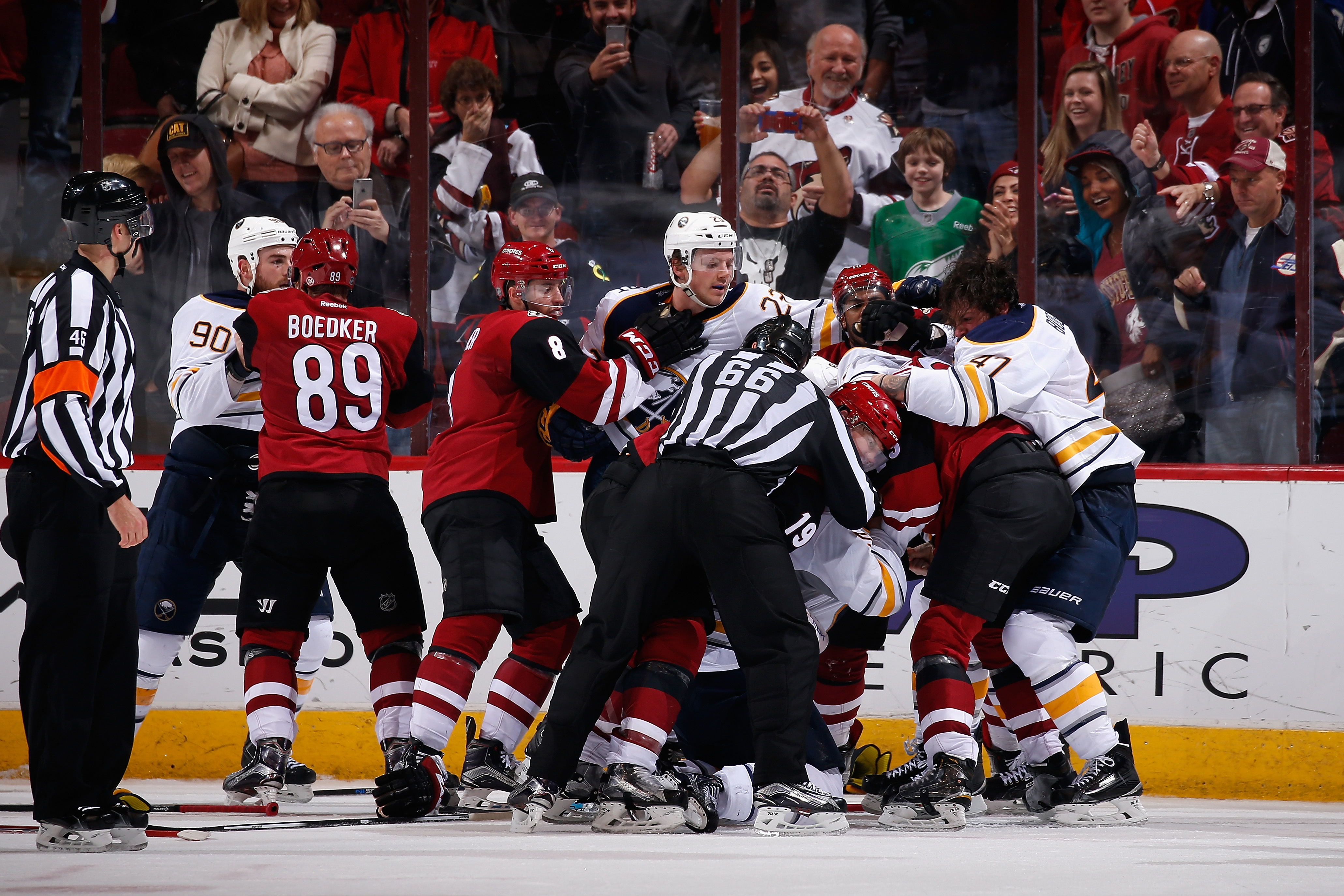The Sabres and Coyotes got together for a postgame scrum. (Getty Images)