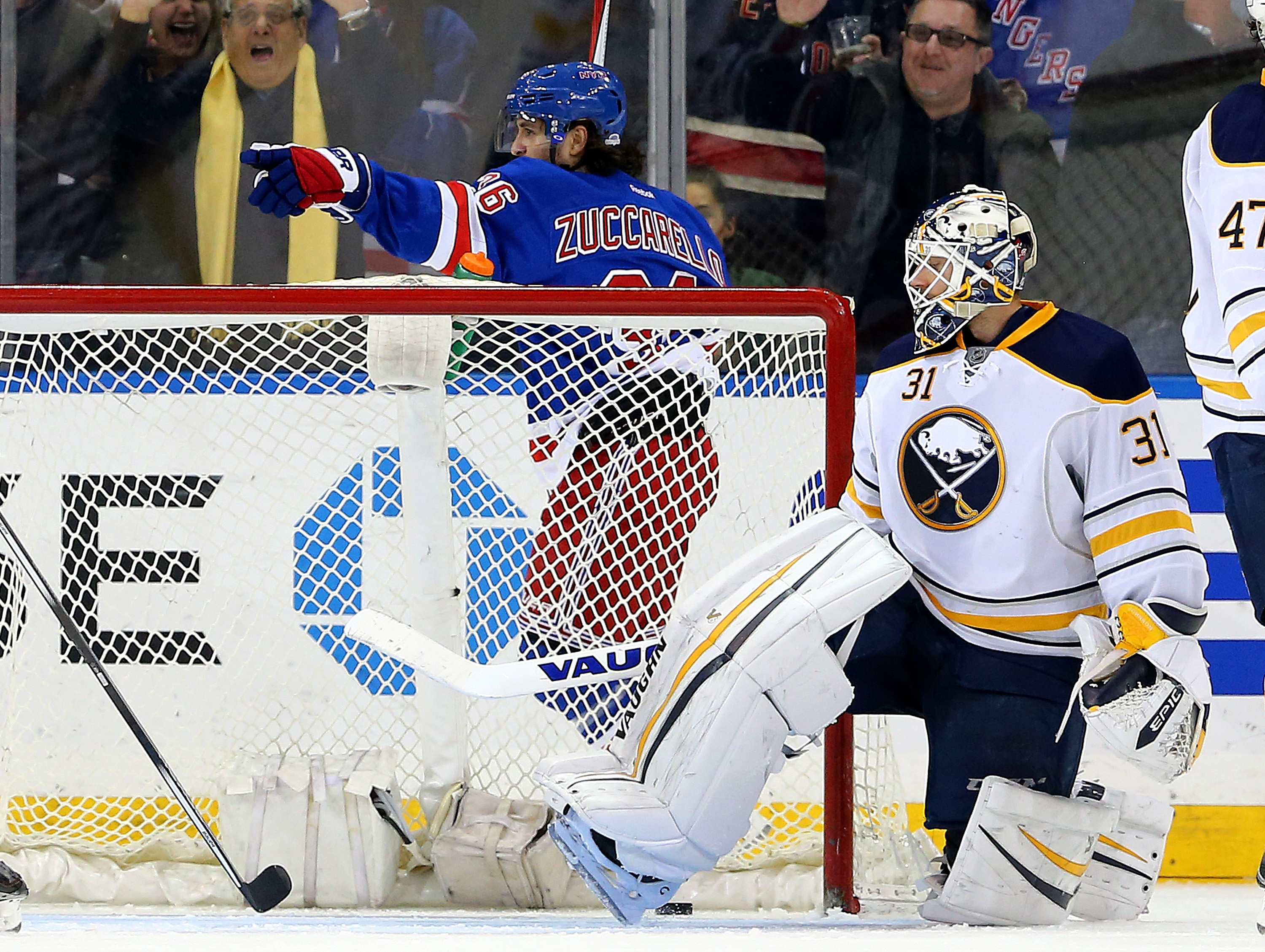Mats Zuccarello of the New York Rangers celebrates his goal as goalie Chad Johnson of the Buffalo Sabres looks on in the third period at Madison Square Garden. (Getty Images)