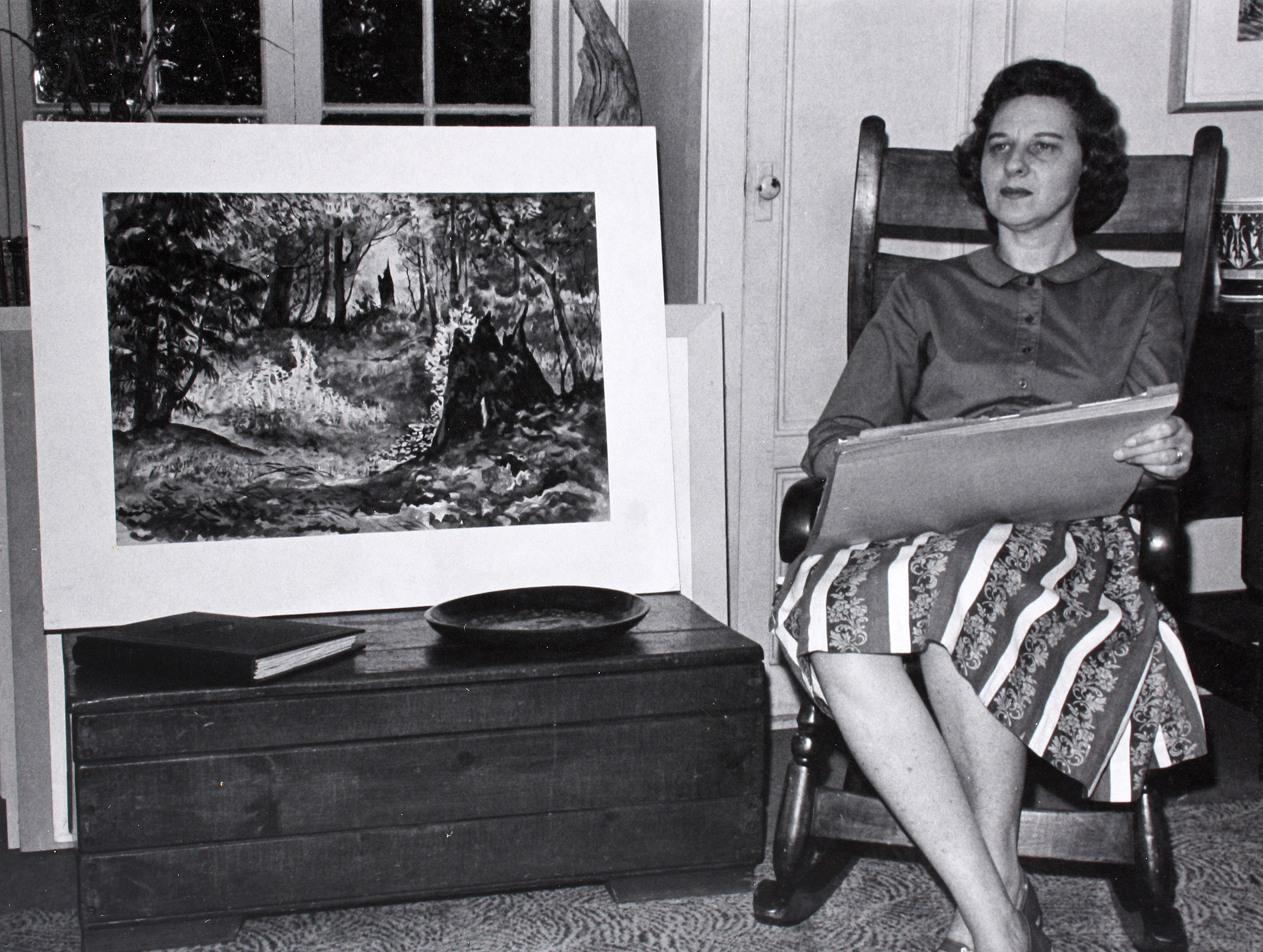 Jeanette Blair, shown here in a family photograph posing next to one of her paintings, died on Jan. 6, 2016.