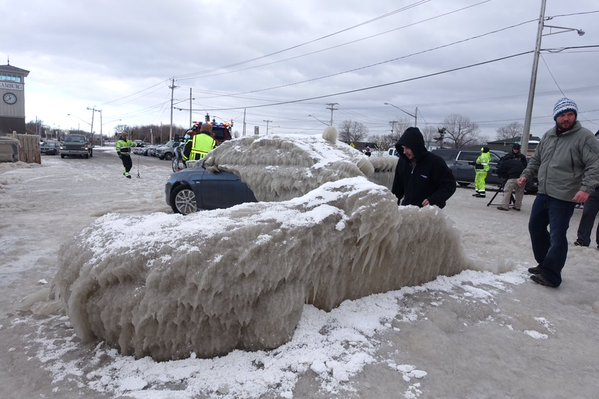 """Part of the shell from the """"ice car"""" as crews get ready to haul it from the Hoak's parking lot in Hamburg. (John Hickey/Buffalo News)"""