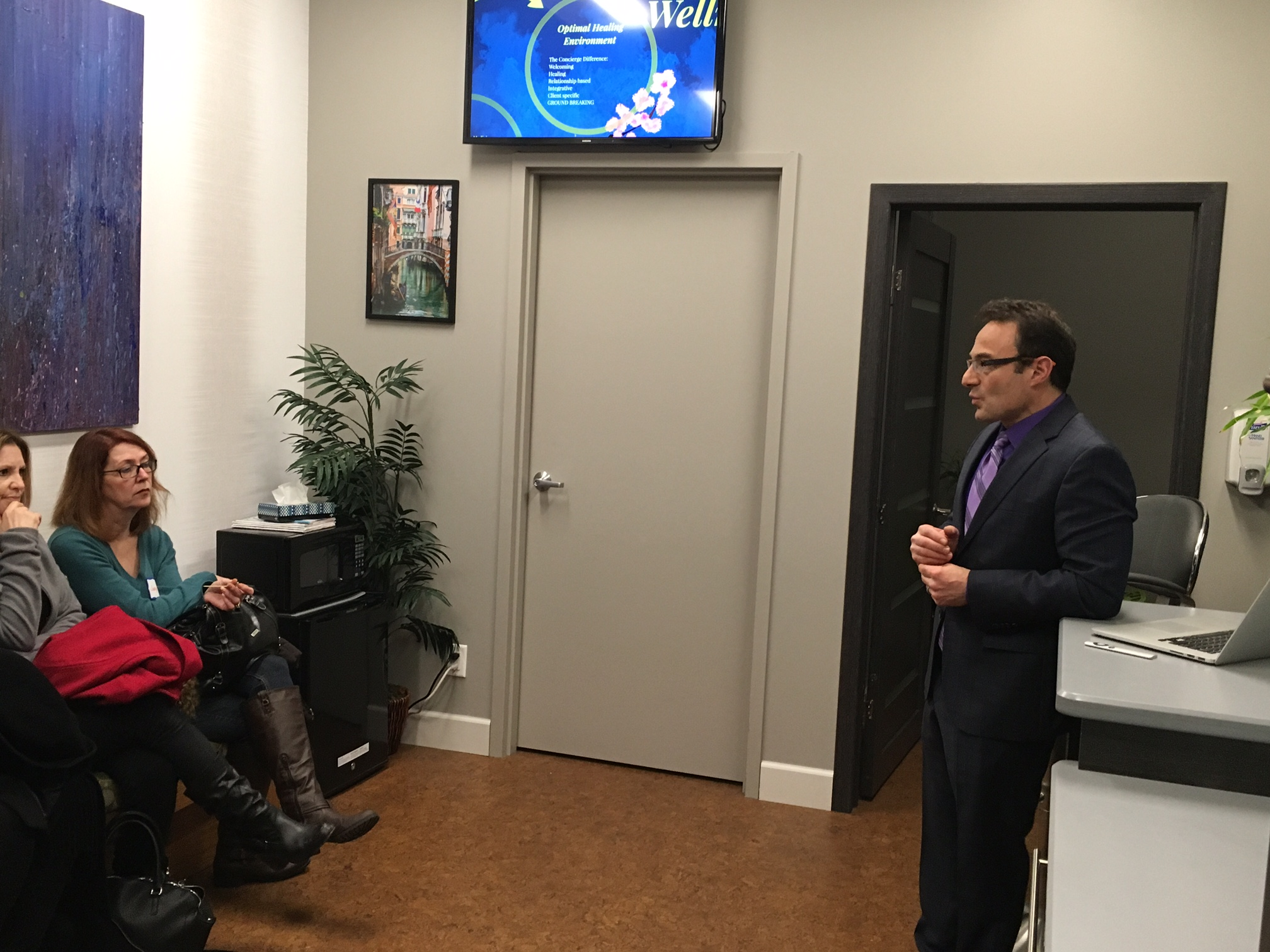 Dr. Leonard Kaplan leads a presentation Thursday night during an open house at Osteopathic Wellness Medicine of WNY. Holistic health services, and even the artwork on the walls, are for sale in his new Elmwood Avenue practice. (Photos by Scott Scanlon)