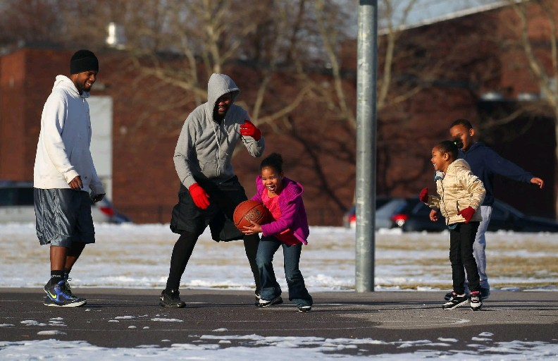Snowfall has been so scarce in January, there's been mid-winter outdoor basketball in Buffalo. (Mark Mulville/Buffalo News)