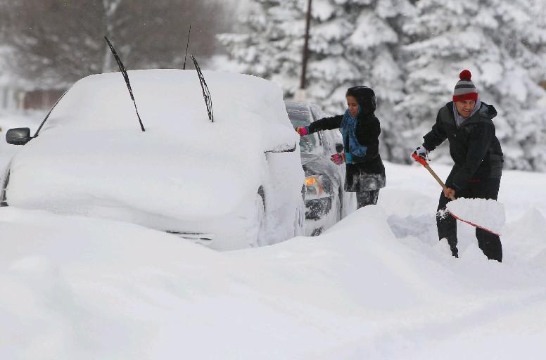 Two years ago today, these Lackawanna residents were digging out their cars from the January 2014 blizzard that struck Western New York. (Mark Mulville/Buffalo News)