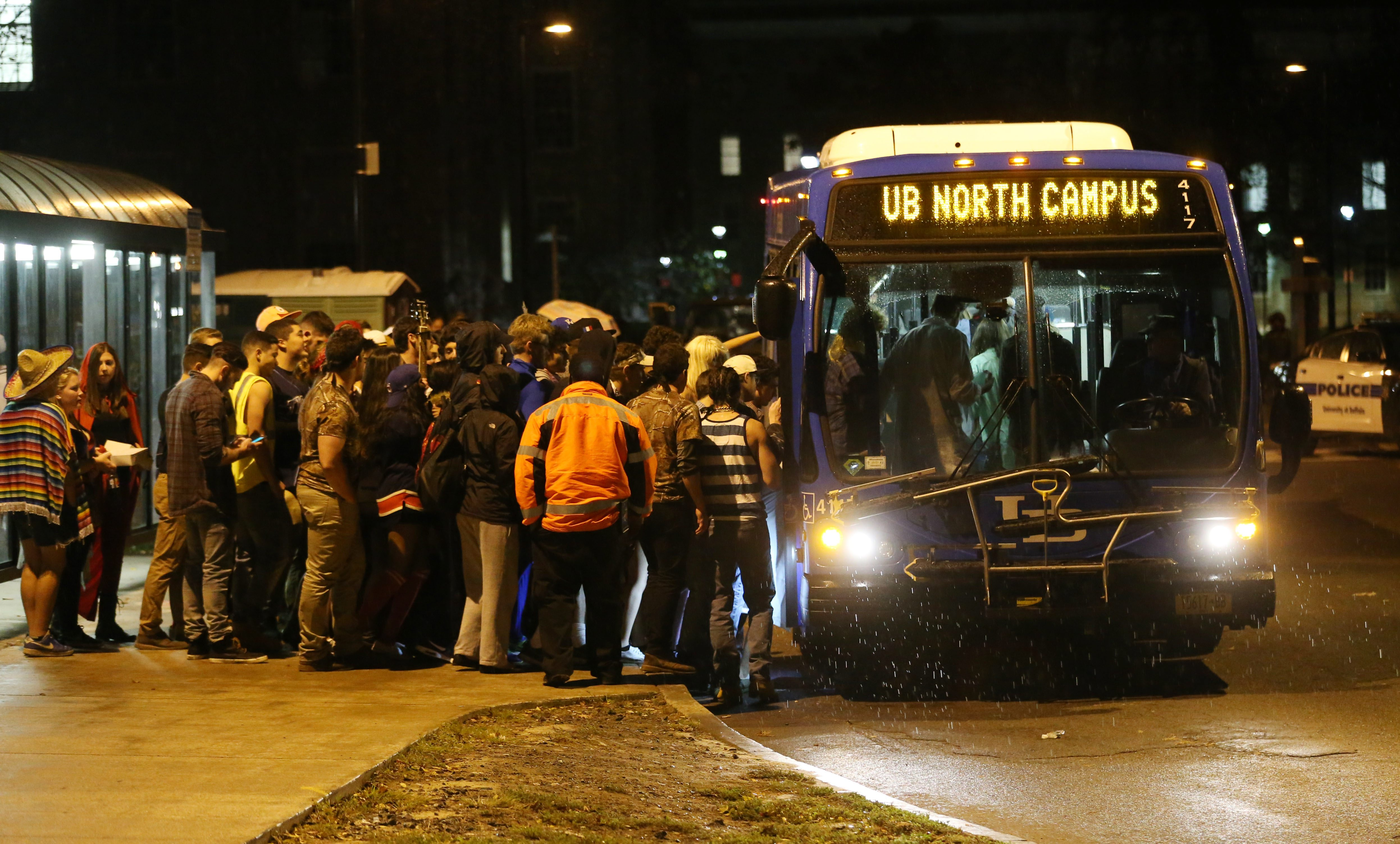 Students pile on the bus at UB South campus to go back to the North Campus at about 1:25 a.m. on Halloween, Sunday, Nov. 1, 2015.   (Sharon Cantillon/Buffalo News)
