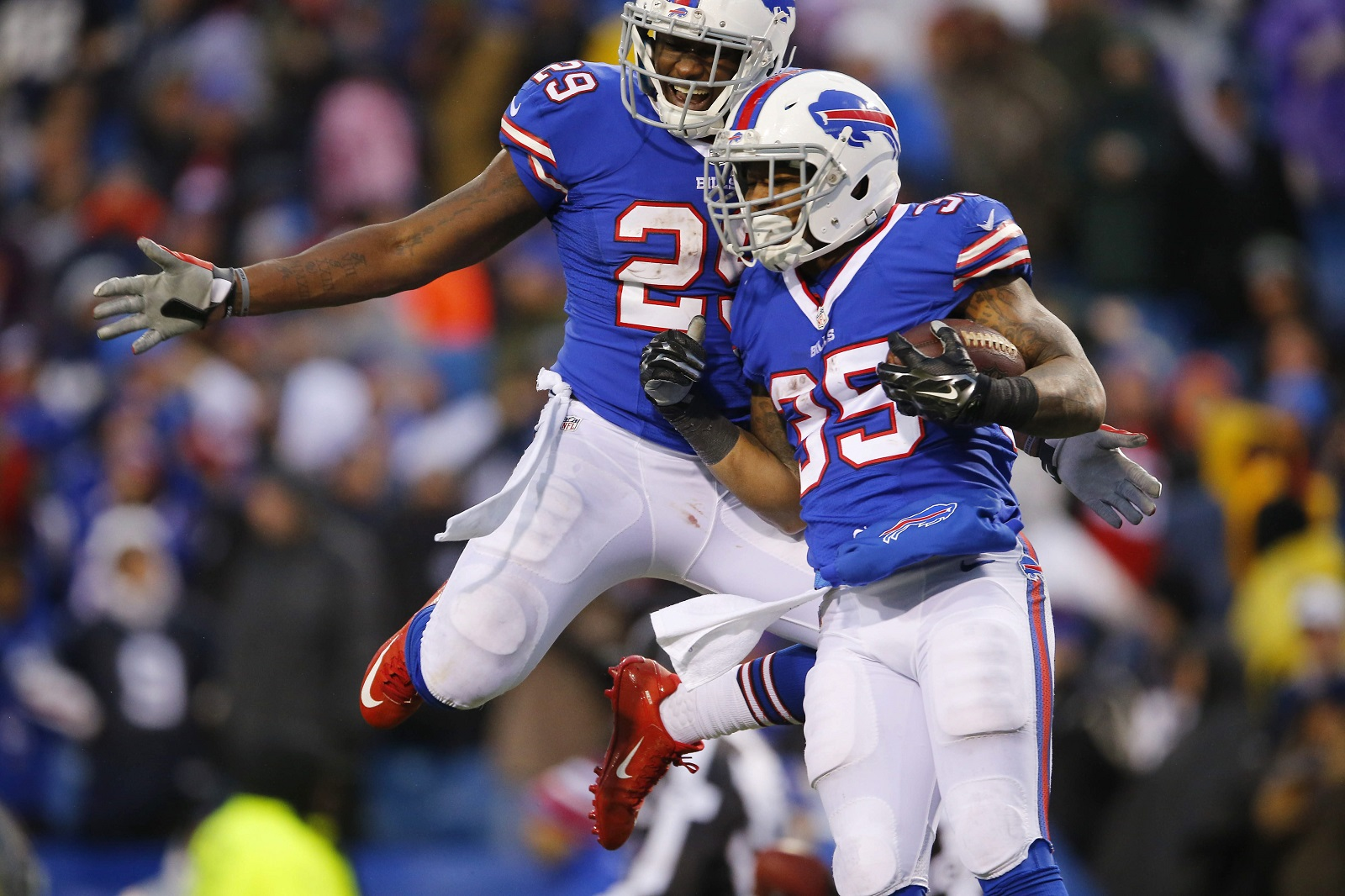 Karlos Williams, left, celebrates with fellow former Bills running back Mike Gillislee (Mark Mulville/Buffalo News file photo)