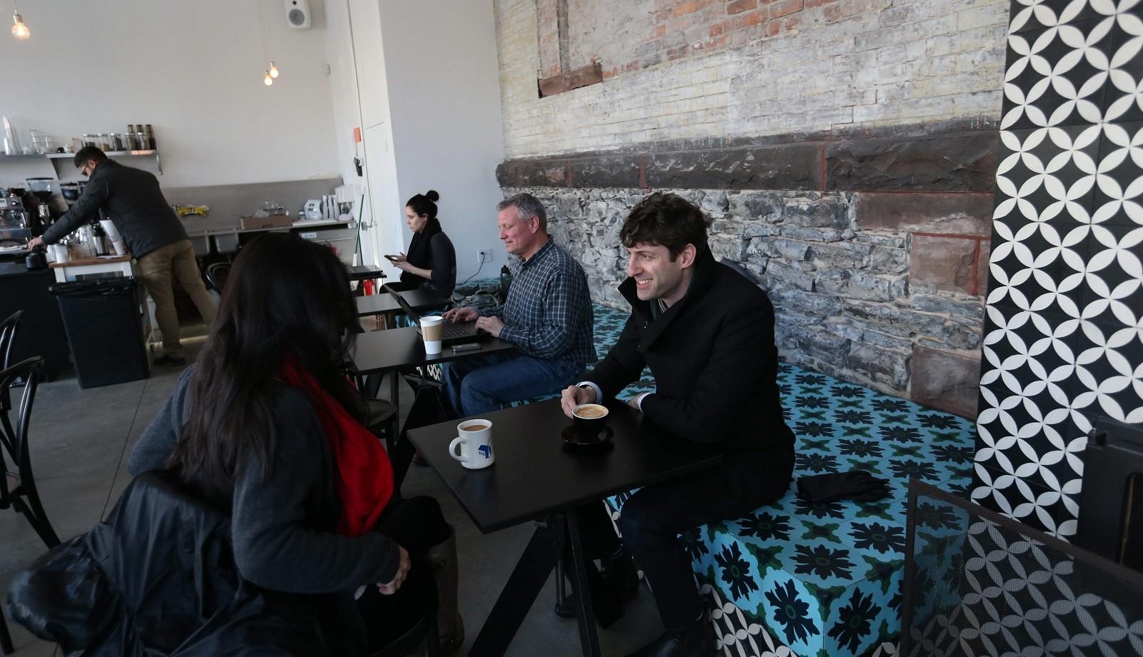Ana Misenas, left and Adam Sokol enjoy some coffee and conversation at Tipico on Fargo Street. (Sharon Cantillon/Buffalo News)