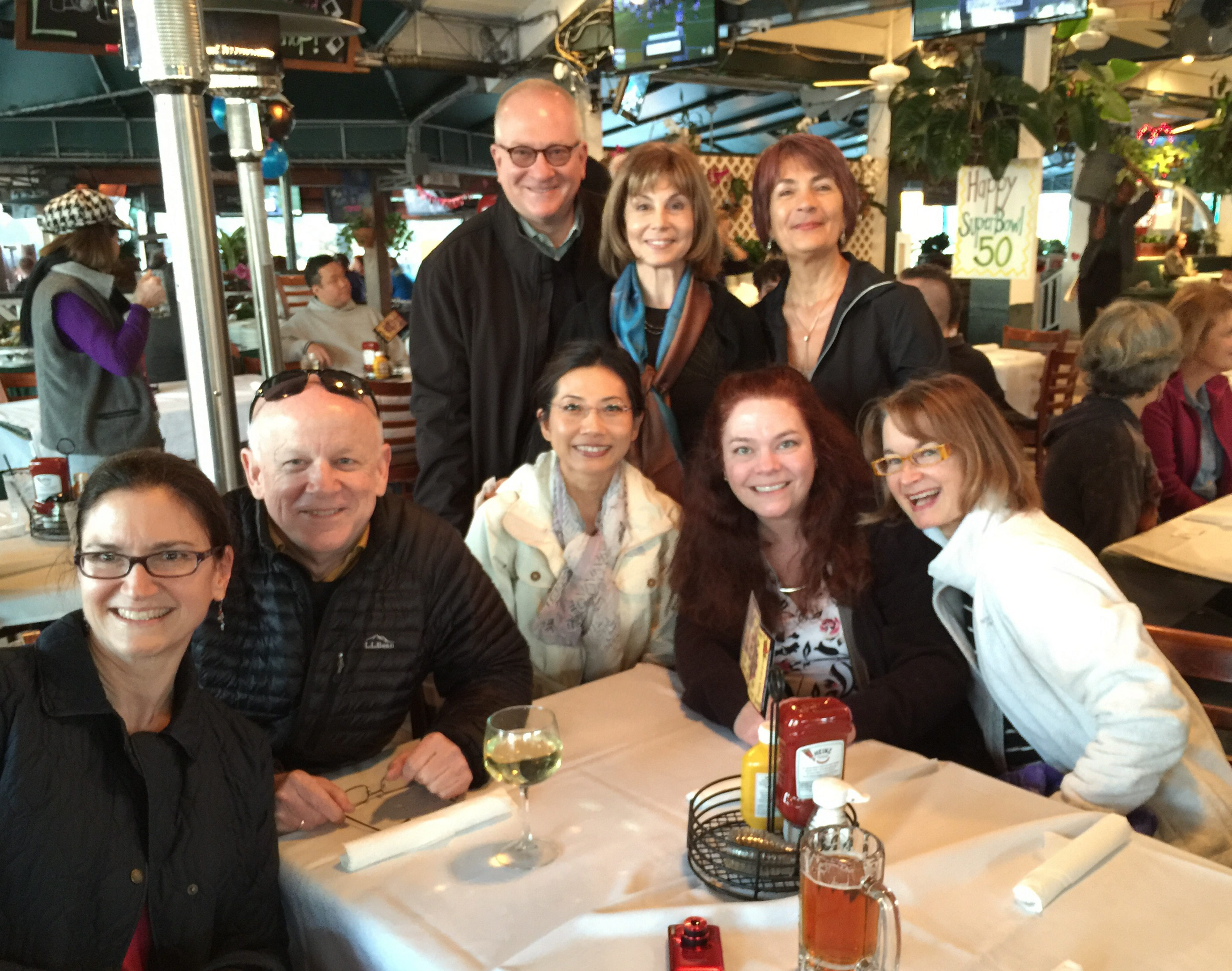 The BPO celebrates its success at a Super Bowl party on Sunday. Front row, from left, are violinists Andrea Blanchard Cone and Doug Cone, cellist Feng Hew, violinists Amy Licata and Diana Sachs. In back, from left, are Executive Director Dan Hart, Music Director JoAnn Falletta and violist Natasha Piskorsky.