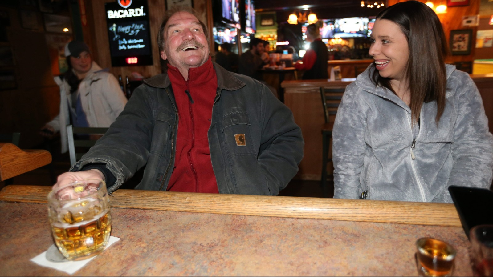 Keith Holmes, left, and Sarah Matthews of the Town of Tonawanda hang out in Caputi's.  (Sharon Cantillon/Buffalo News)