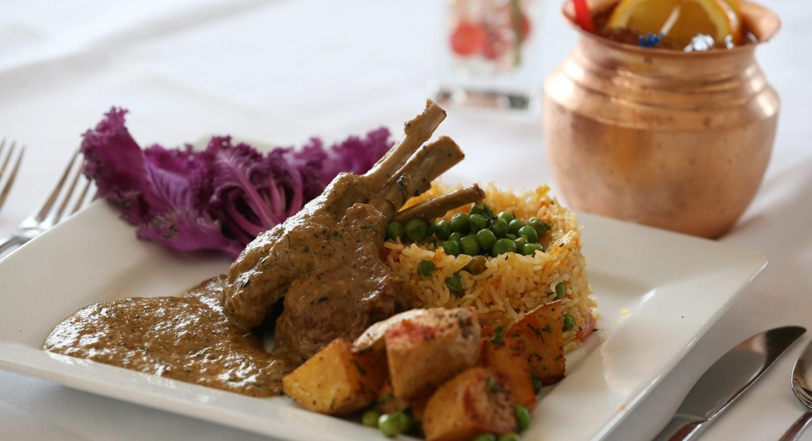 Pan-seared juicy lamb chops marinated in fresh ginger and exotic herbs from Tandoori's. (Sharon Cantillon/Buffalo News)
