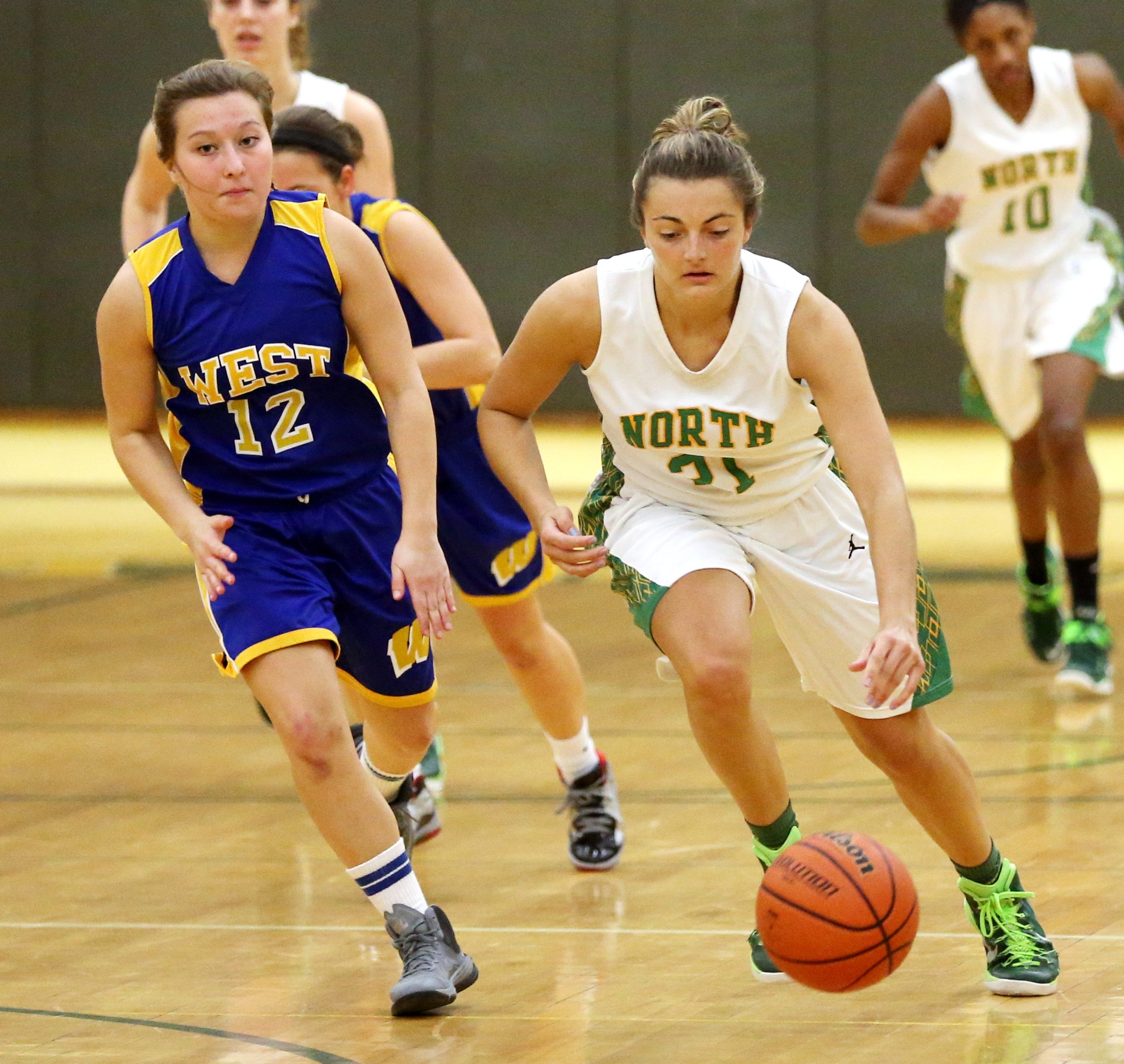 Williamsville North's Clare Ahern heads to the basket past West Seneca West's Casey Villagomez to score two points in her team's 67-40 win.