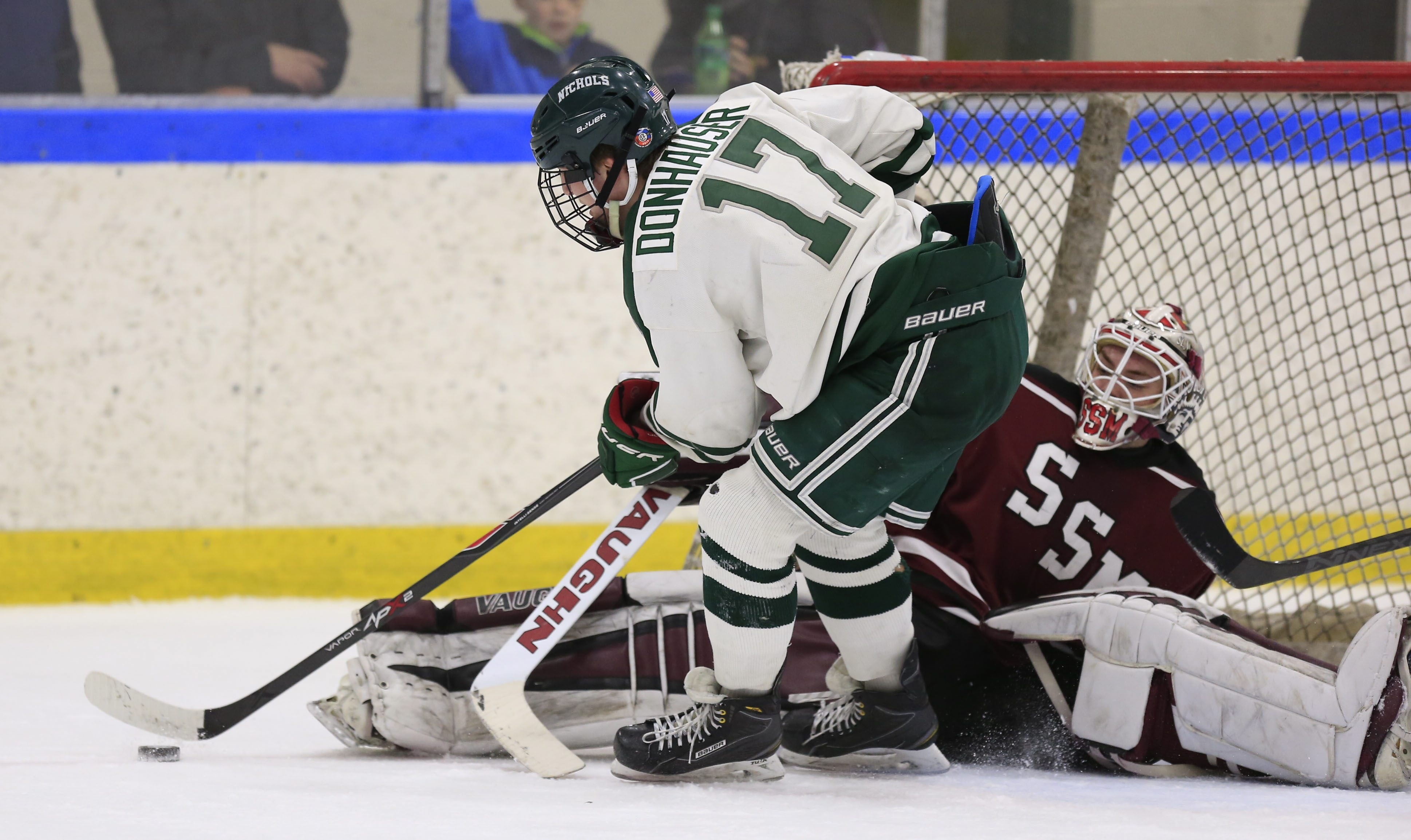 Cole Donhuaser of Nichols gets stopped by Shattuck-St. Mary's goaltender David Tomeo at Dann Memorial Rink Friday. SSM came away with a 5-1 victory.