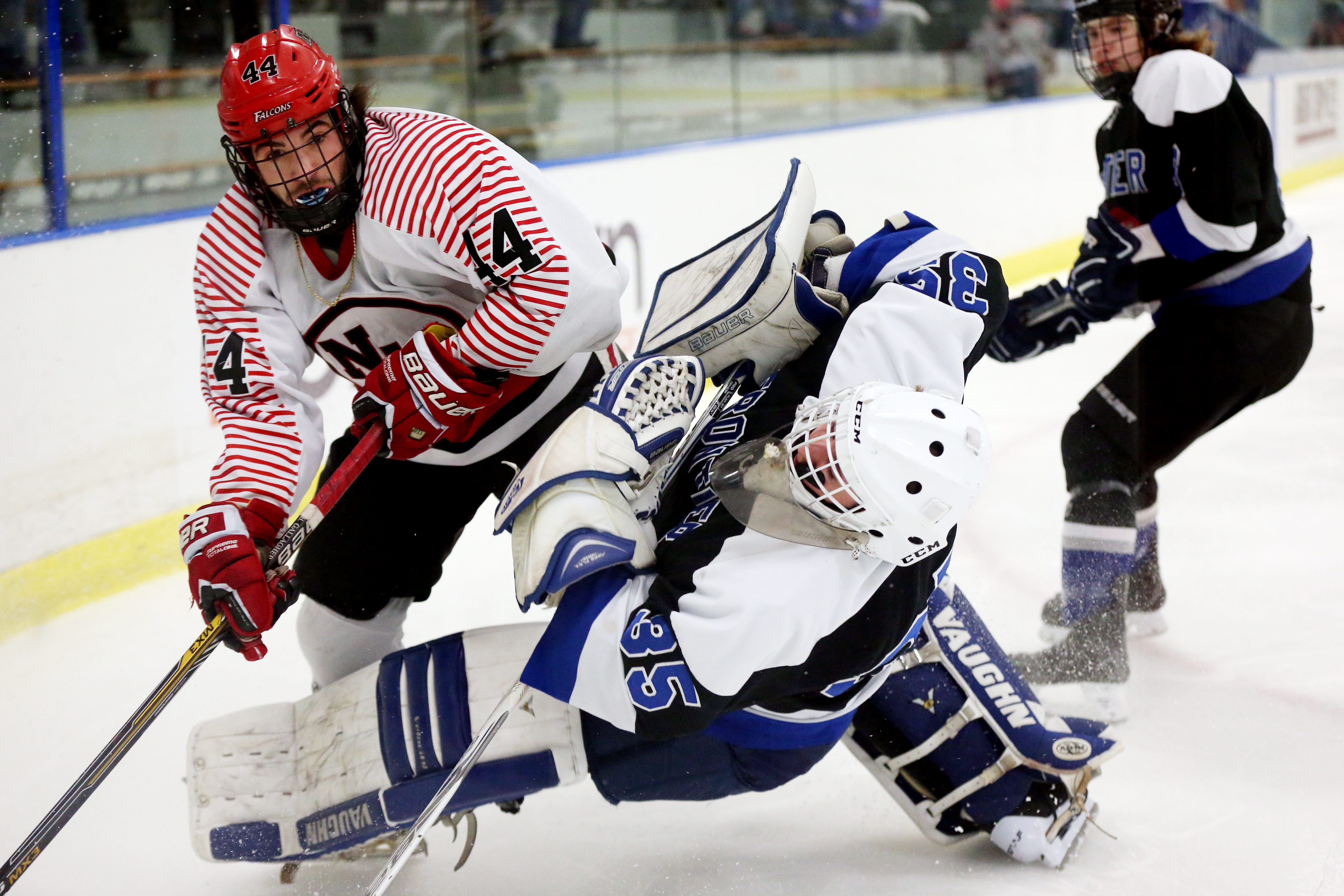 Niagara Wheatfield's Alex Bauer received a penalty for plowing into Frontier goalie Ryan Kaska.