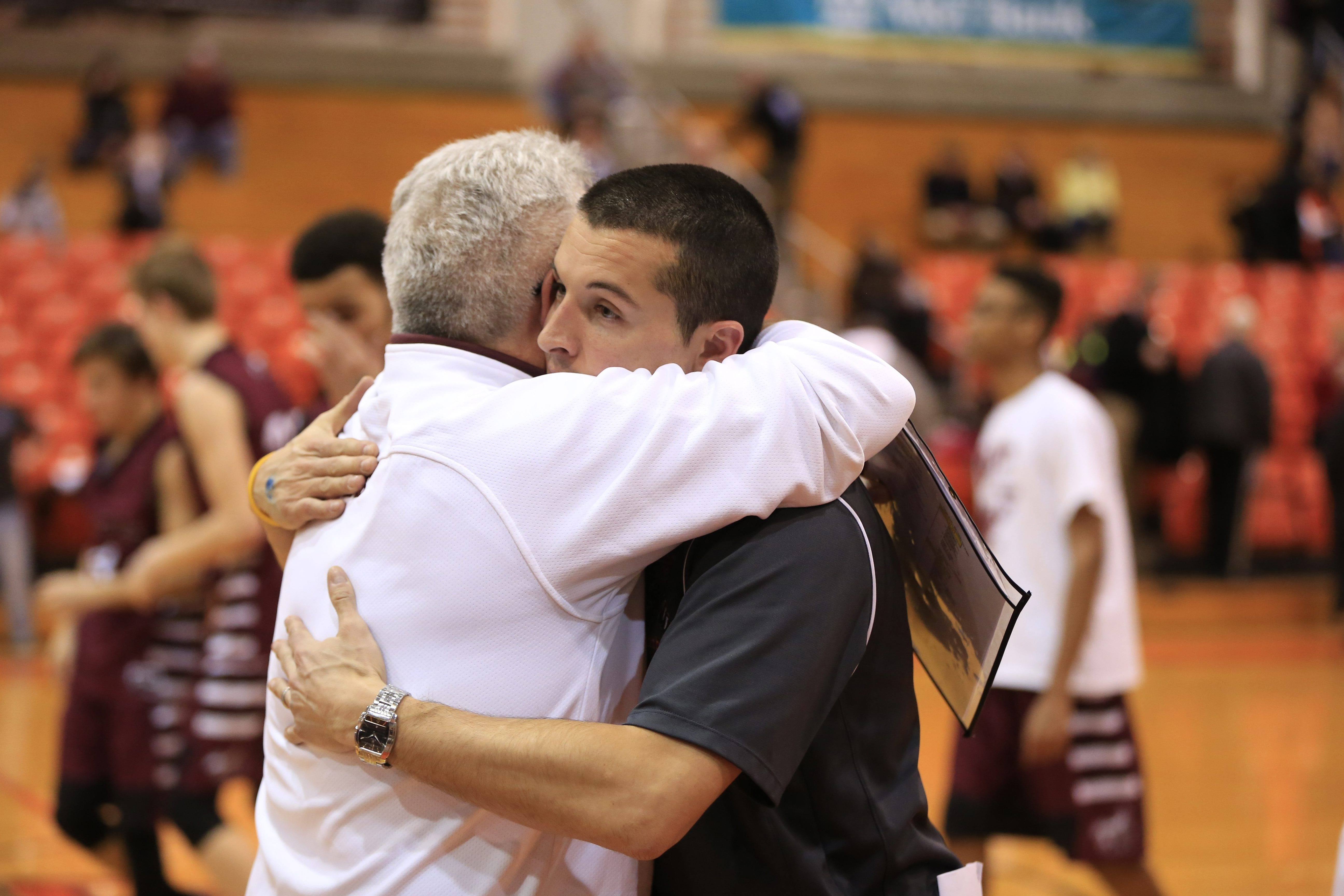 Maryvale coach Mark Kensy and son Chris, coach of Amherst, embrace after  Amherst defeated Maryvale in the A-2 semifinals at the Buffalo State Sports Arena. (Harry Scull Jr./Buffalo News)