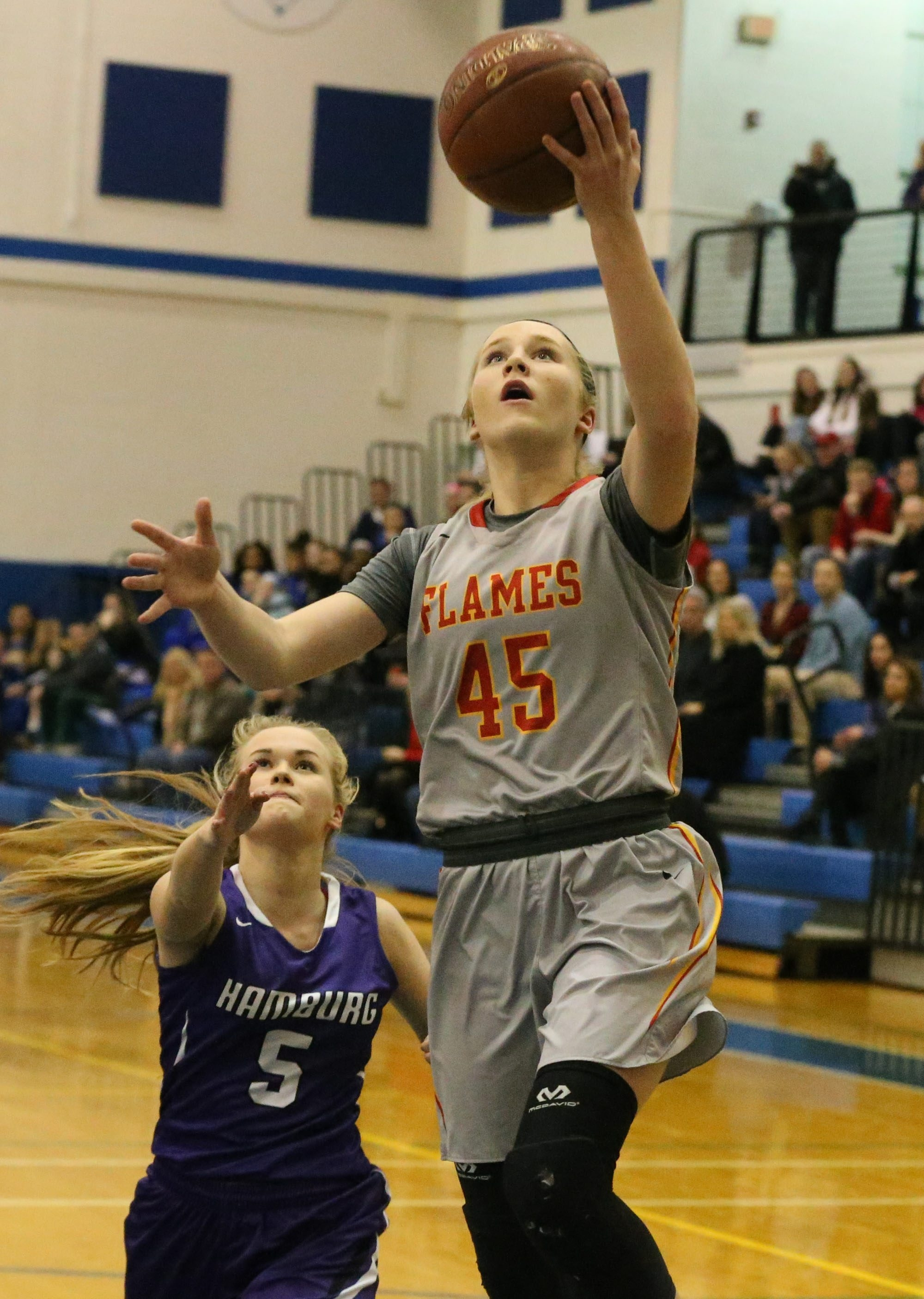 Williamsville East sophomore guard Erica Martinsen goes up for two of her 50 points against Hamburg's Maggie Vesneske.