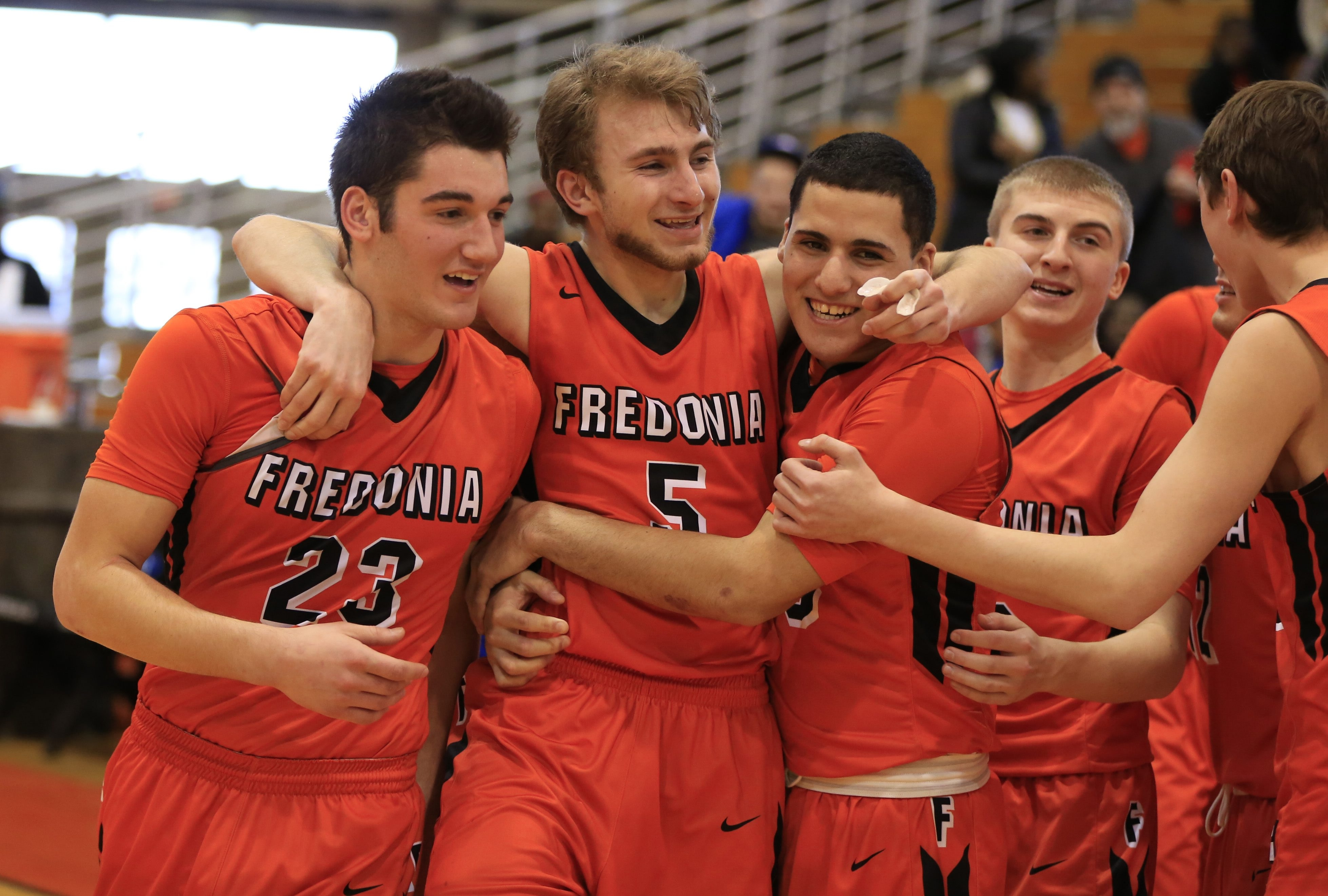 Fredonia players celebrate their victory over Health Science in the Class B-2 semifinals at the Buffalo State Sports  Arena.