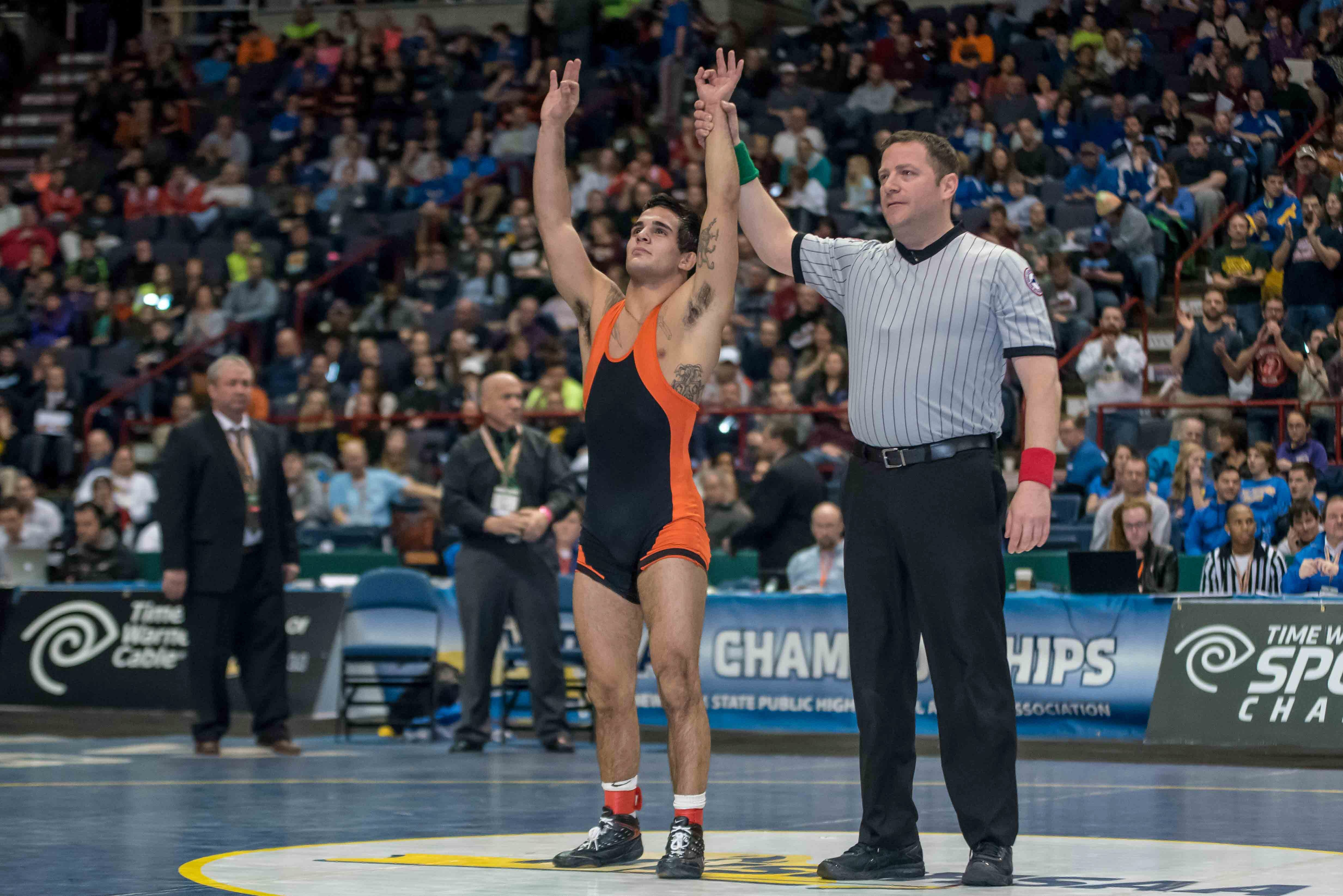 Kellen Devlin of Amherst celebrates winning the 132-pound Division II New York State Championship with a 9-0 win over Ryan O'Rourke of Adirondack.
