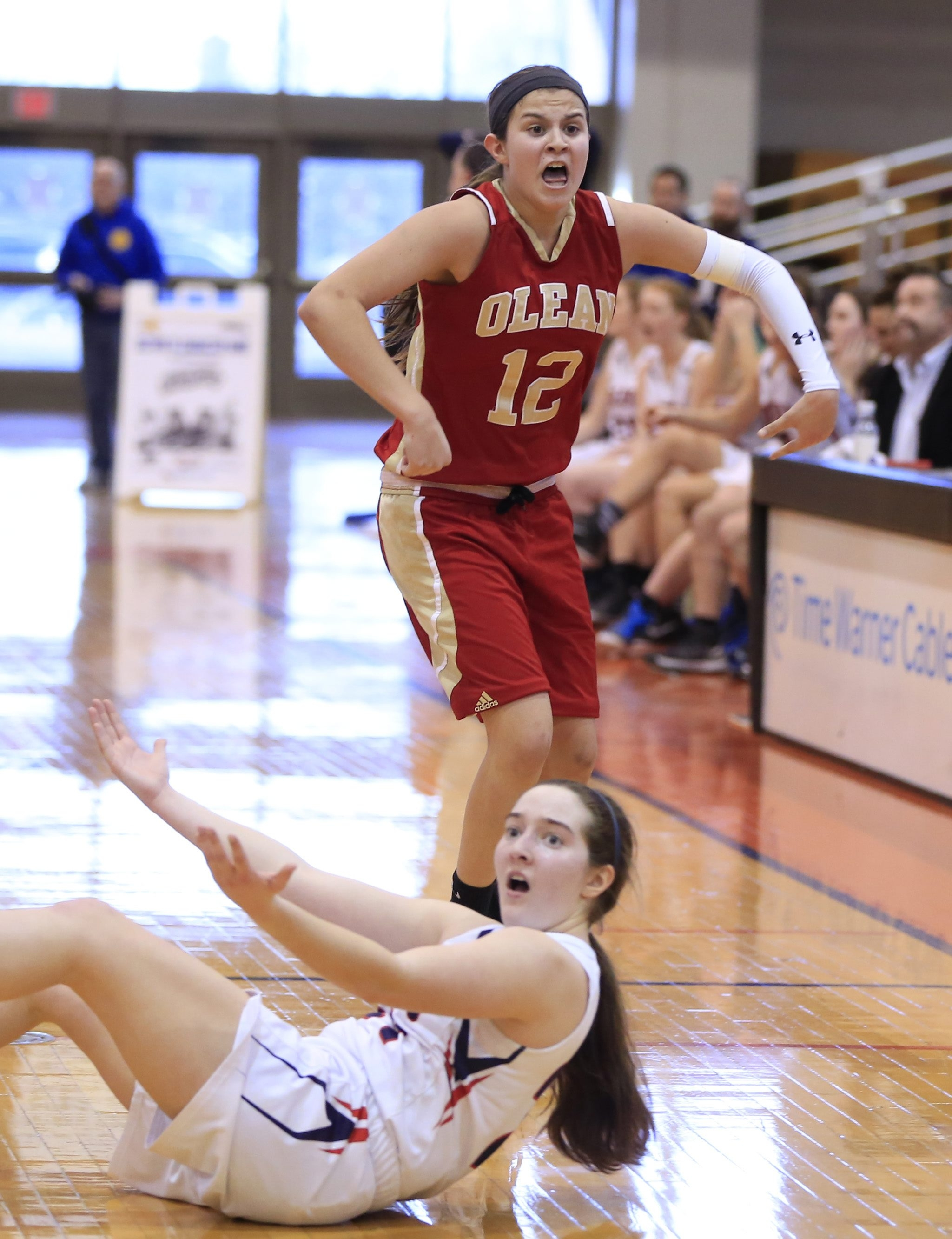 Olean's Sara Pfeiffer celebrates an overtime victory gainst East Aurora  in the B1 final at the Buffalo State Sports Arena  on Sunday, Feb. 28, 2016.  (Harry Scull Jr./Buffalo News)