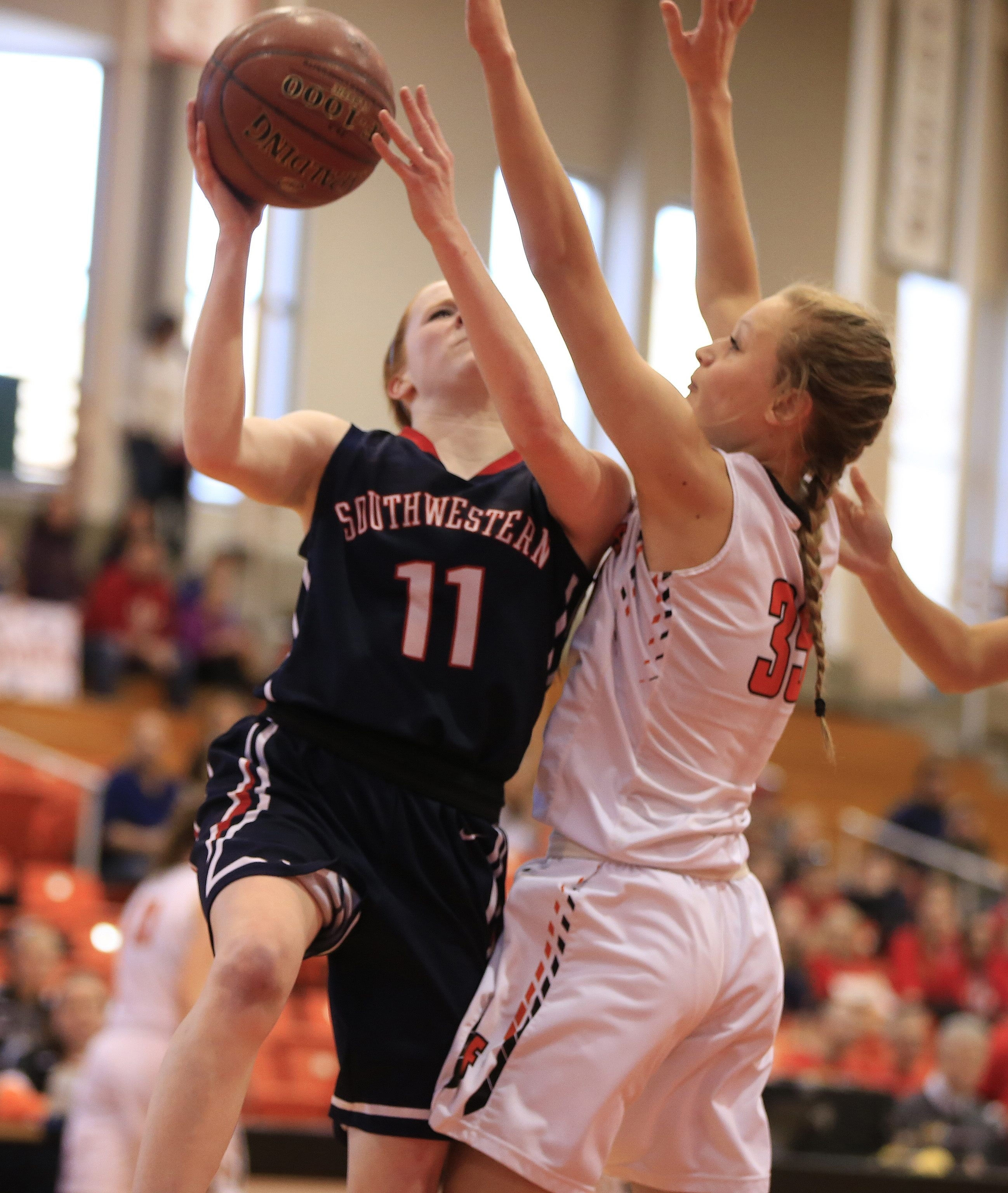 Southwestern's Hayden Burgeson drives against Fredonia during the first half at Buffalo State.