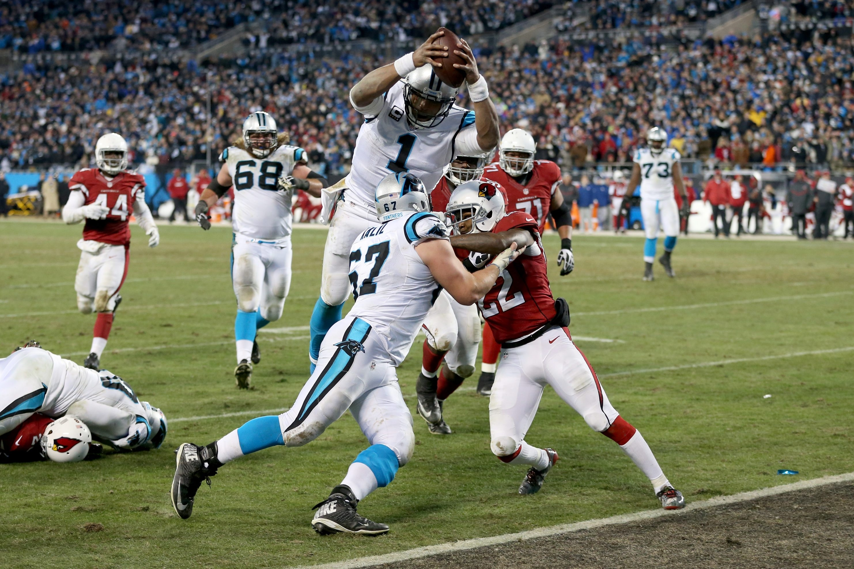 Carolina Panthers quarterback Cam Newton (1) goes for the touchdown against the Arizona Cardinals during the NFC Championship Game at Bank of America Stadium on Jan. 24, 2016, in Charlotte, N.C.
