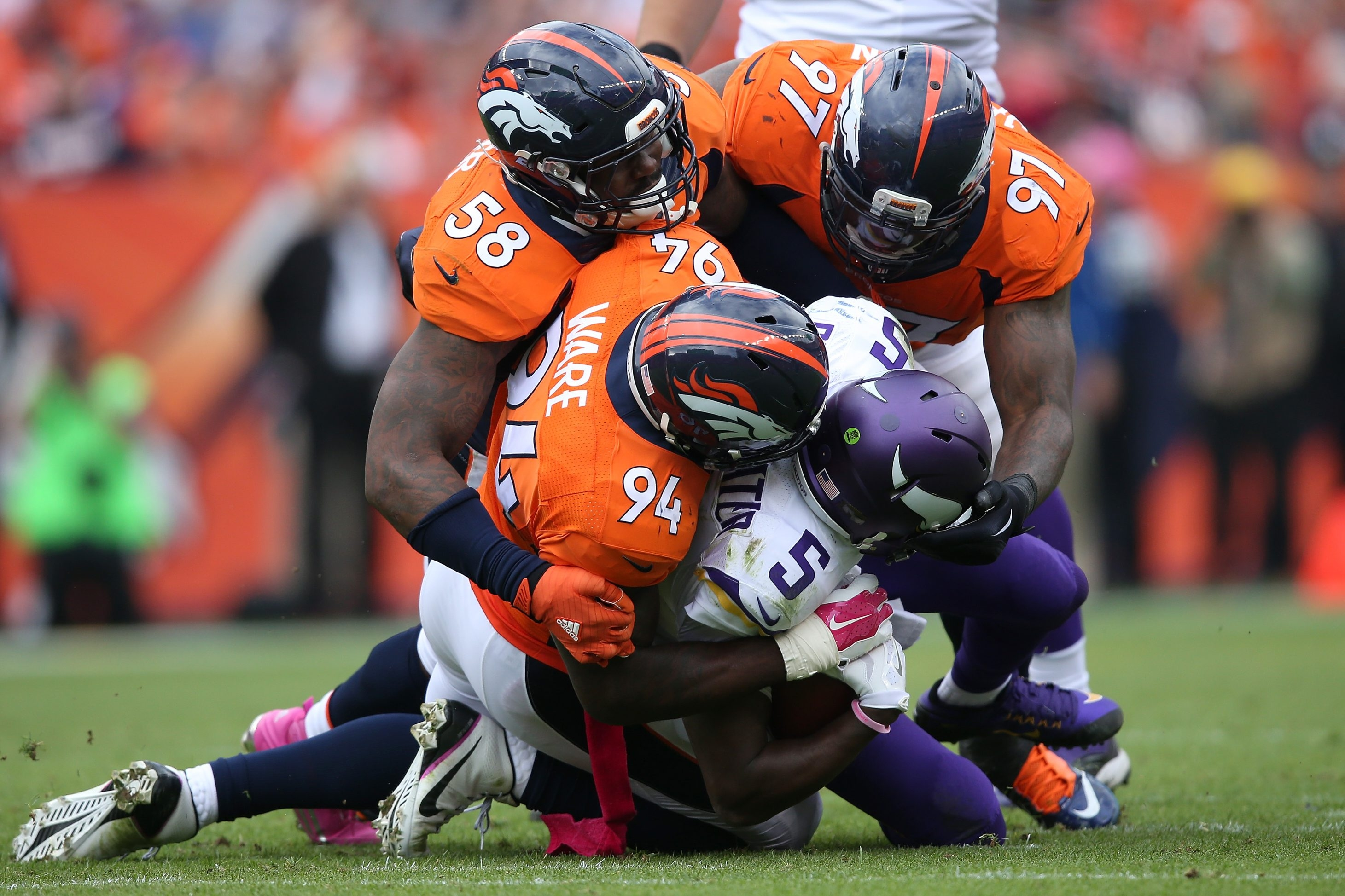 Outside linebacker Von Miller, linebacker DeMarcus Ware and defensive end Malik Jackson of the Denver Broncos gang tackle quarterback Teddy Bridgewater of the Minnesota Vikings in their game in Denver on Oct. 4. (Photo by Doug Pensinger/Getty Images)