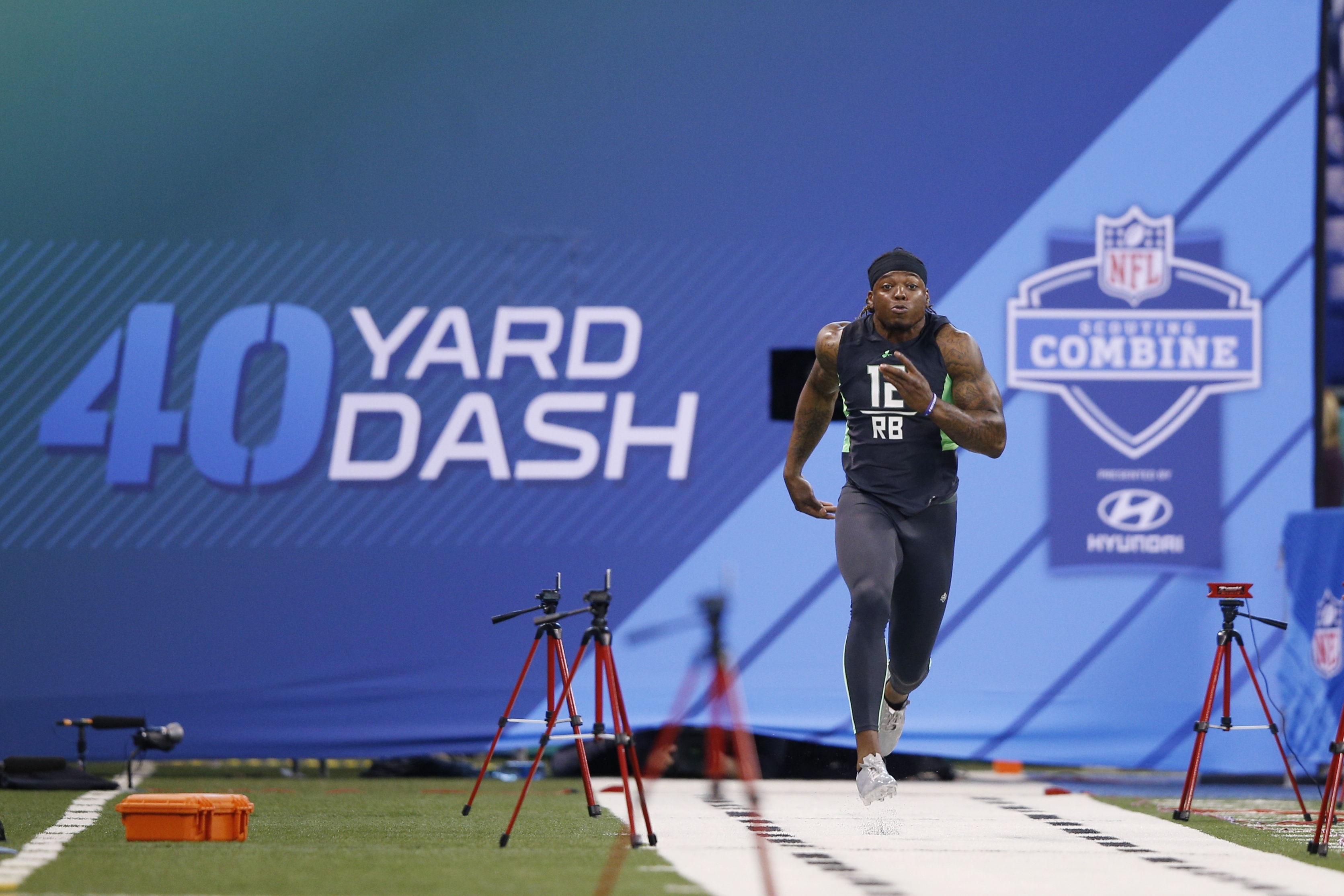 Alabama running back Derrick Henry of runs the 40-yard dash Friday during the 2016 NFL Scouting Combine in Indianapolis.
