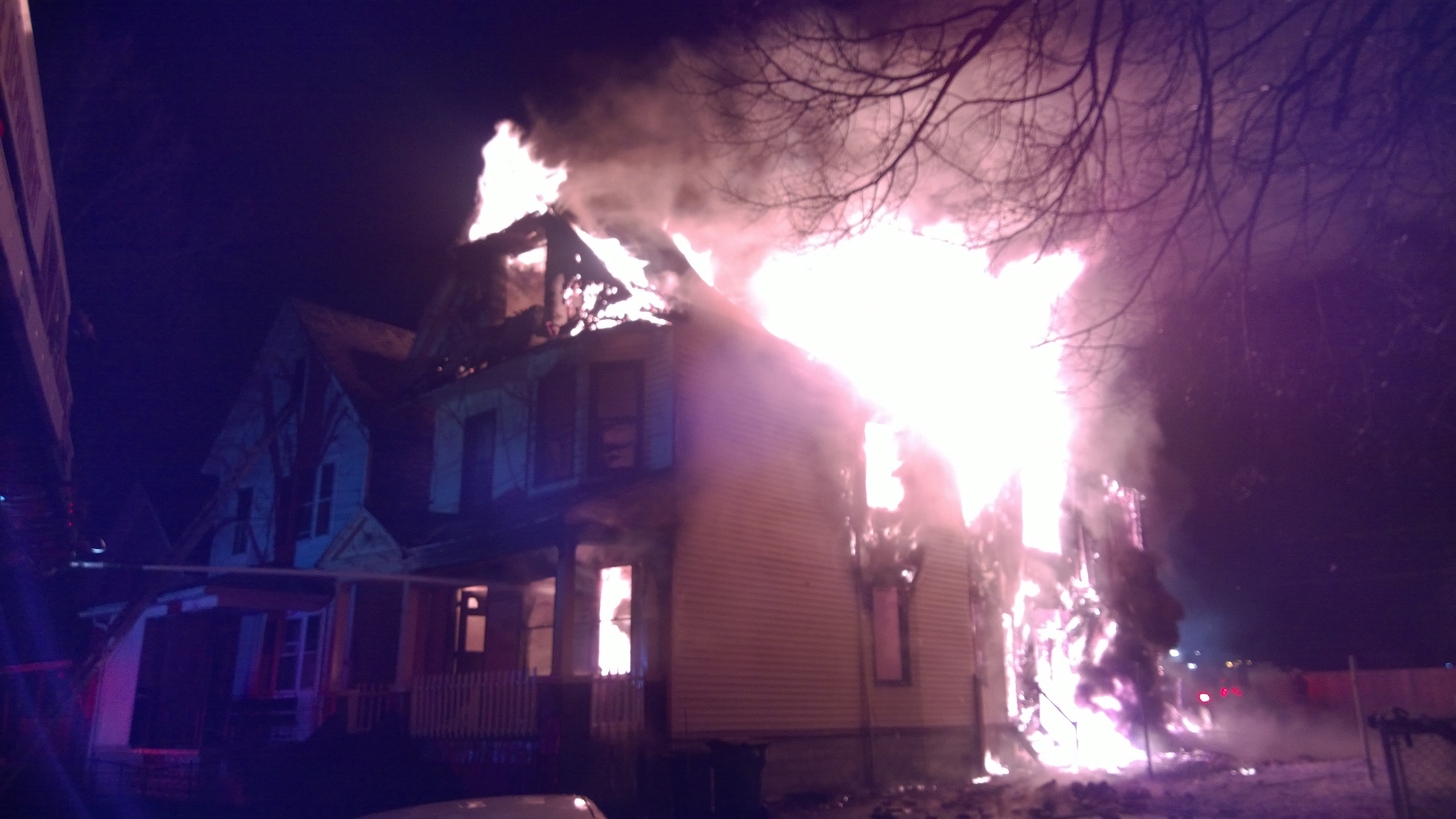 Flames shoot from a home on South Division early Tuesday Feb. 2, 2016. (David Kazmierczak/Special to The News)
