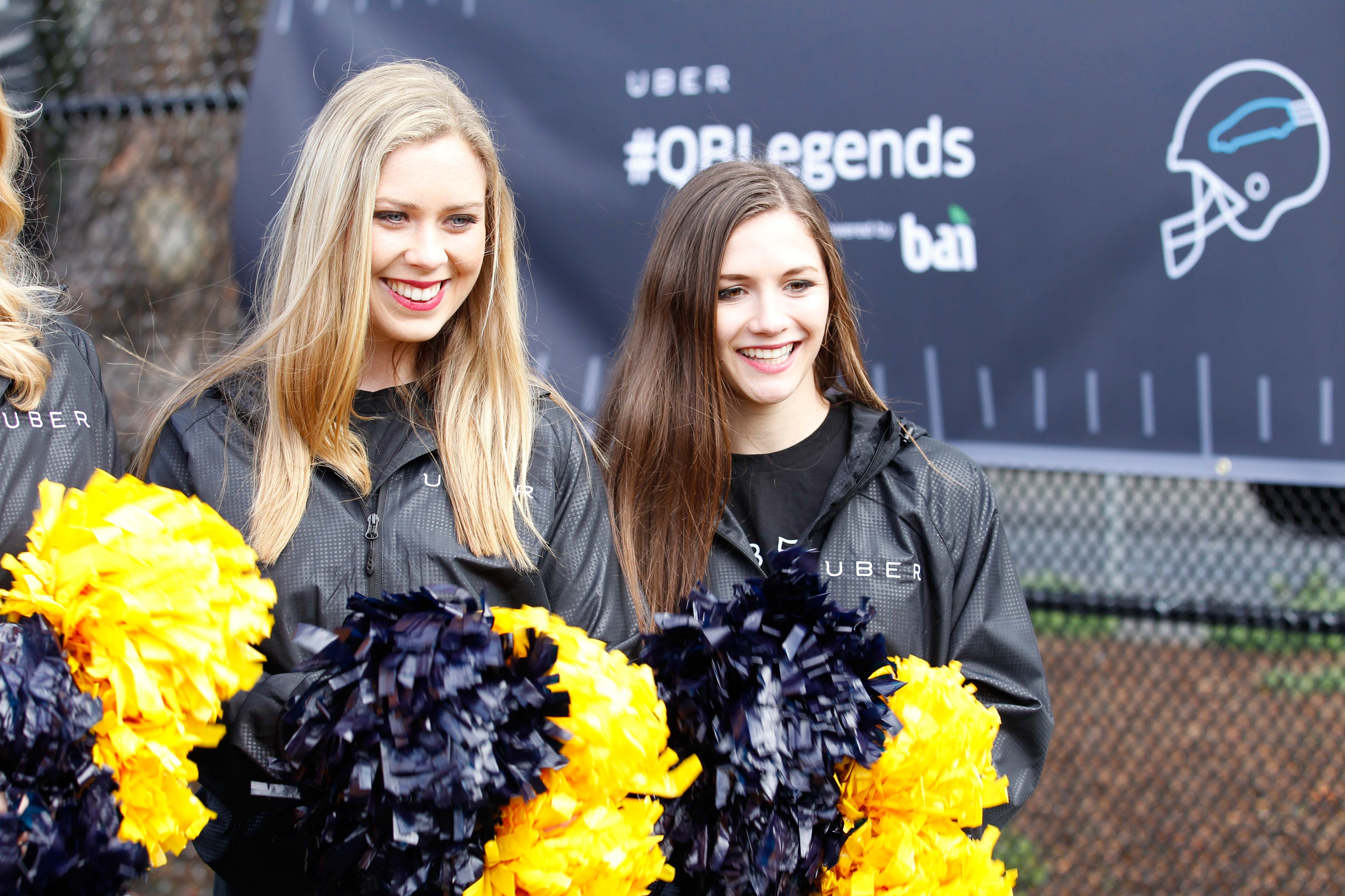 """Three cheers for football: Cheerleaders attend """"QB Legends On Demand"""" presented by Uber and Bai on Thursday at a playground in San Francisco, site of this Sunday's Super Bowl."""