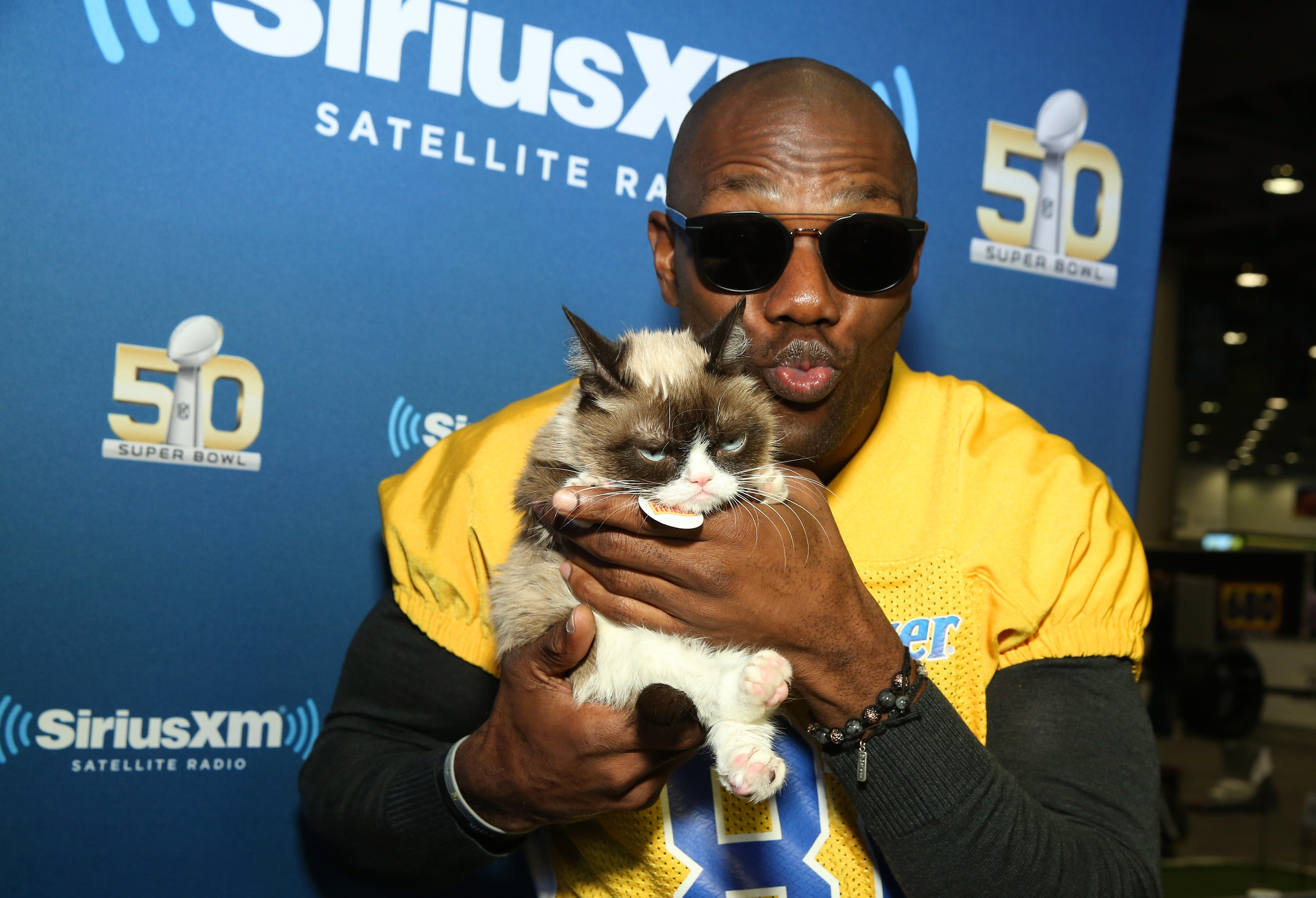Super celebrities: Former NFL player and Buffalo Bill Terrell Owens and Grumpy Cat attend SiriusXM at Super Bowl 50 Radio Row at Moscone Center on Thursday in San Francisco.