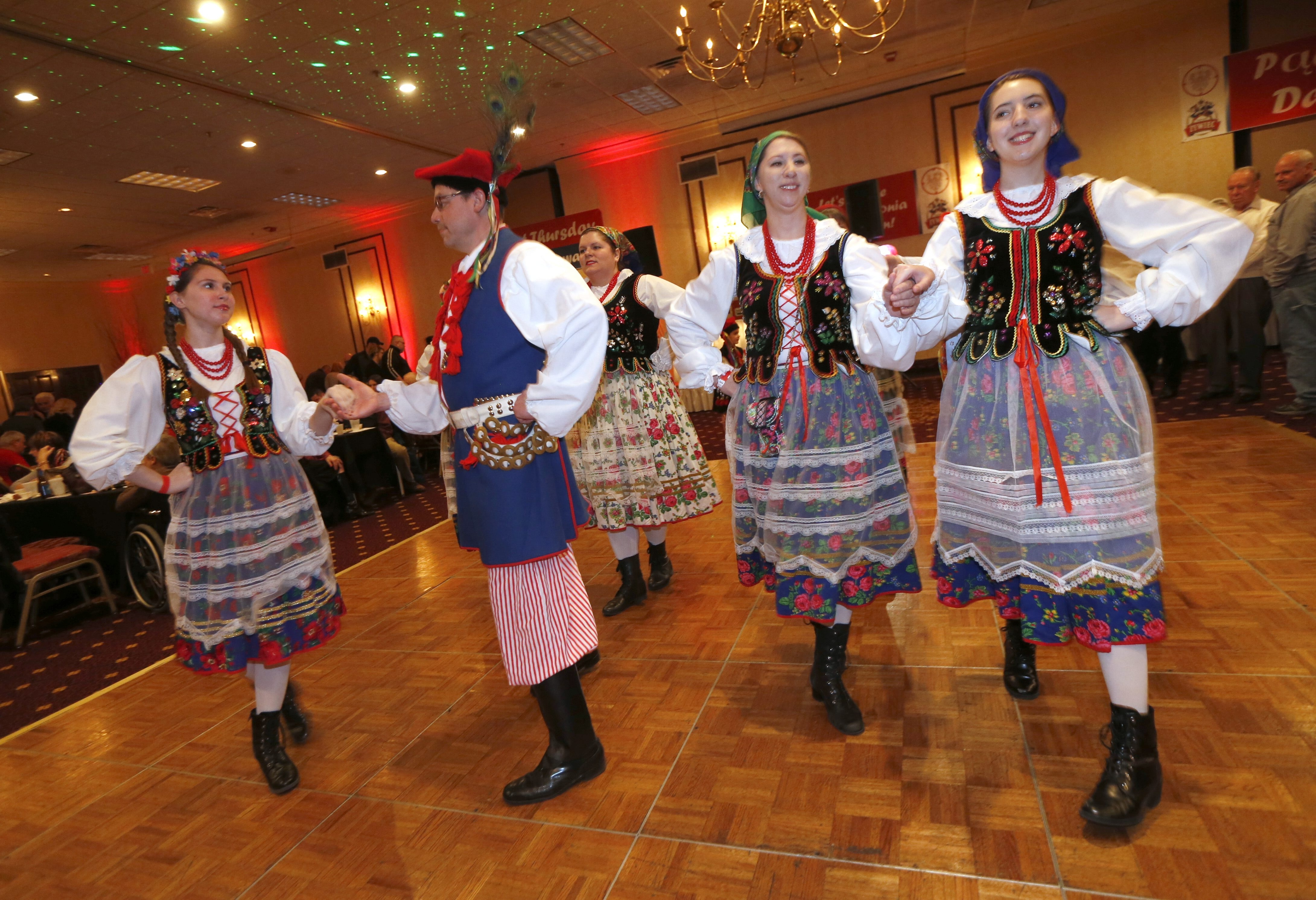 Members of the Harmony Polish Polka Ensemble perform a traditional walking dance during the pre-Lenten Fat Thursday celebration at the Millennium Hotel in Cheektowaga on Thursday.