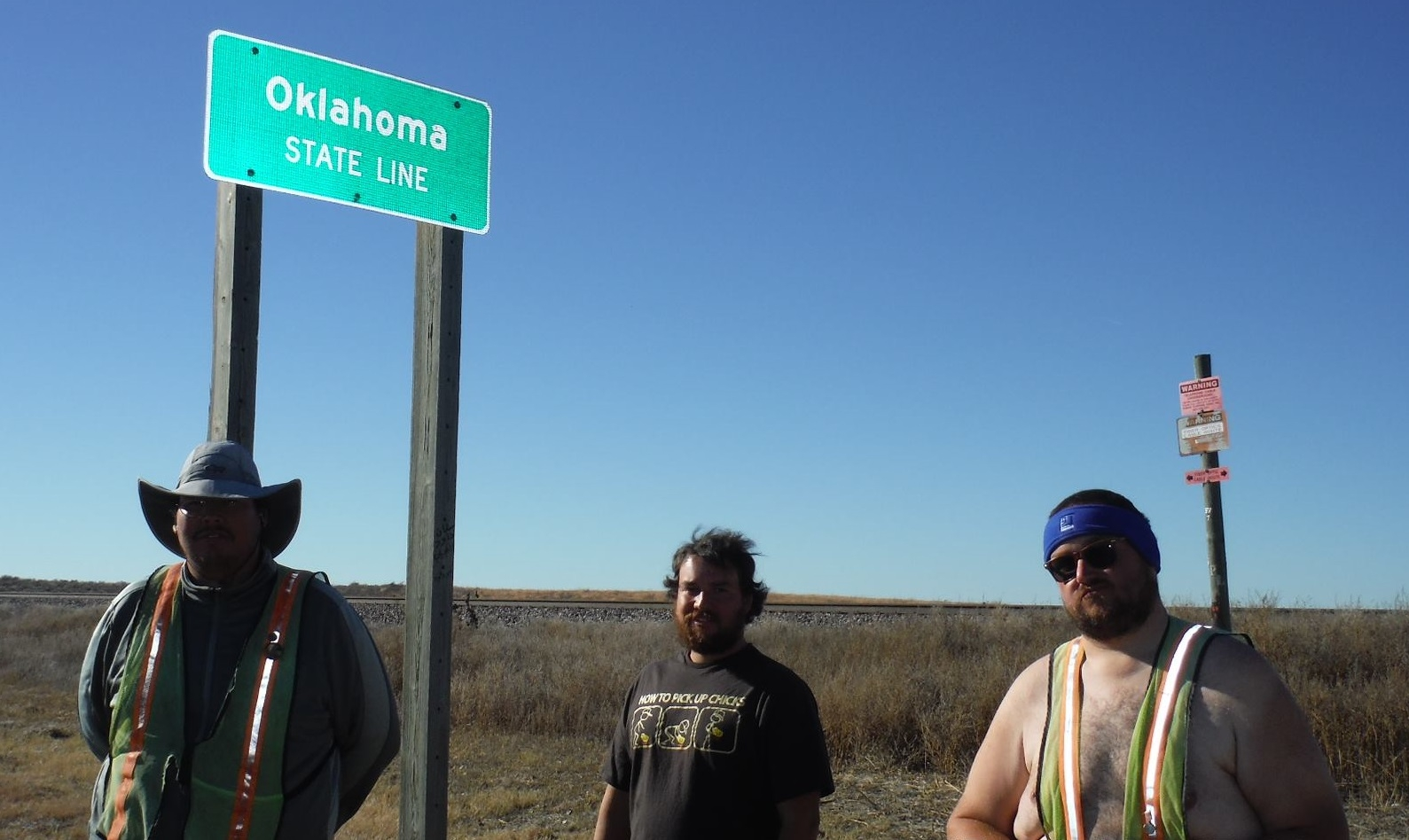 From left, Christopher Cooke, Joe Cooke and Jason Rogers at the Oklahoma state line.